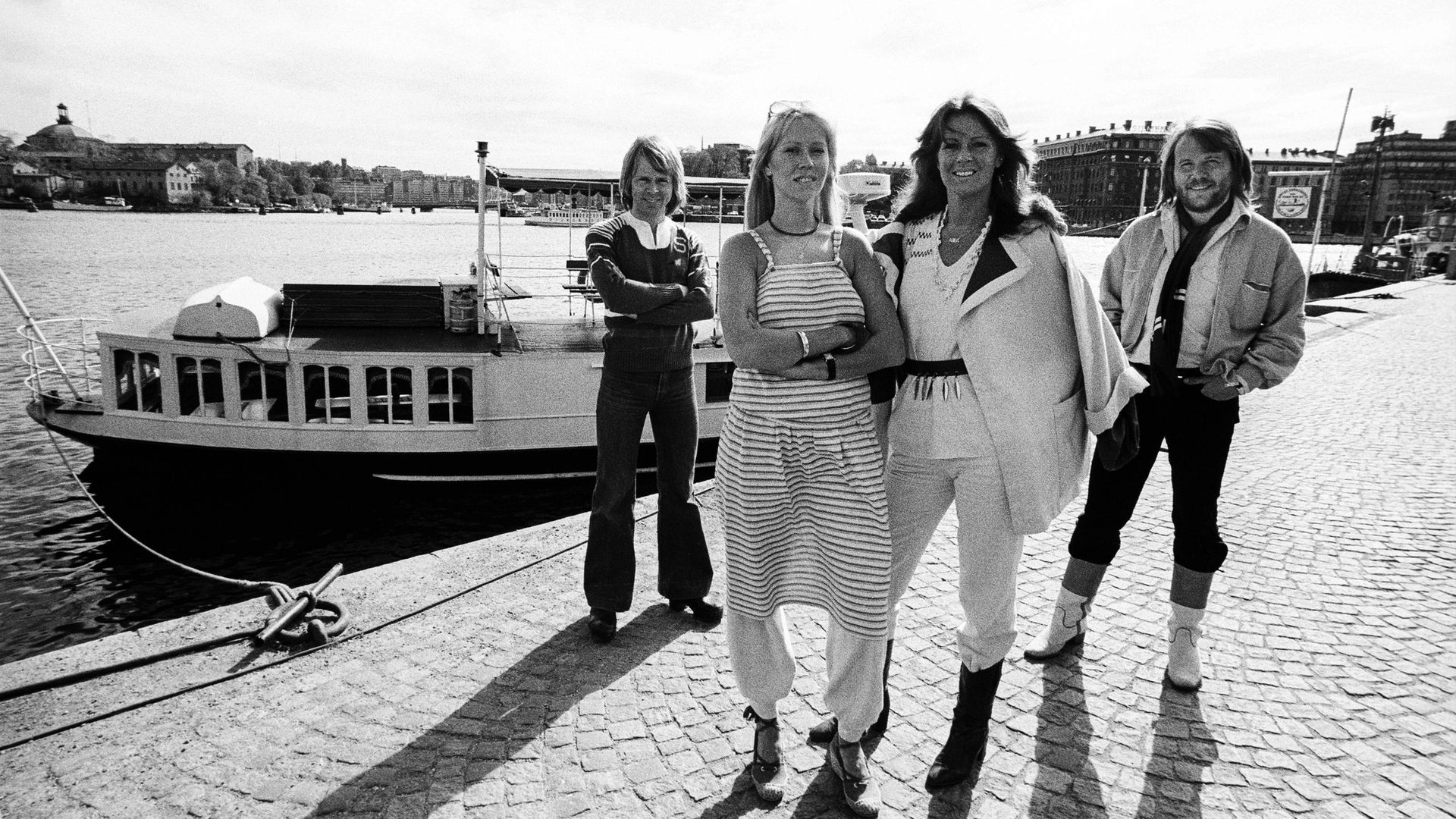 ABBA pose dockside in Stockholm's Gamla Stan (Old Town) in July 1977. Pictured from left: Bjorn Ulvaeus, Agnetha Faltskog, Anni-Frid Lyngstad, and Benny Andersson - Credit: Getty Images