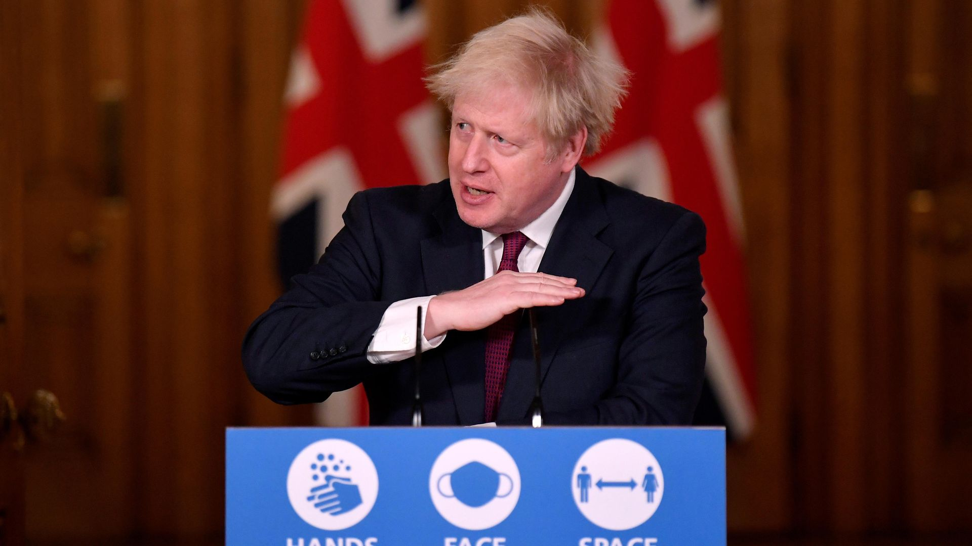 Prime Minister Boris Johnson speaks during a news conference in response to the ongoing situation with the Covid-19 pandemic, at 10 Downing Street, London. - Credit: PA