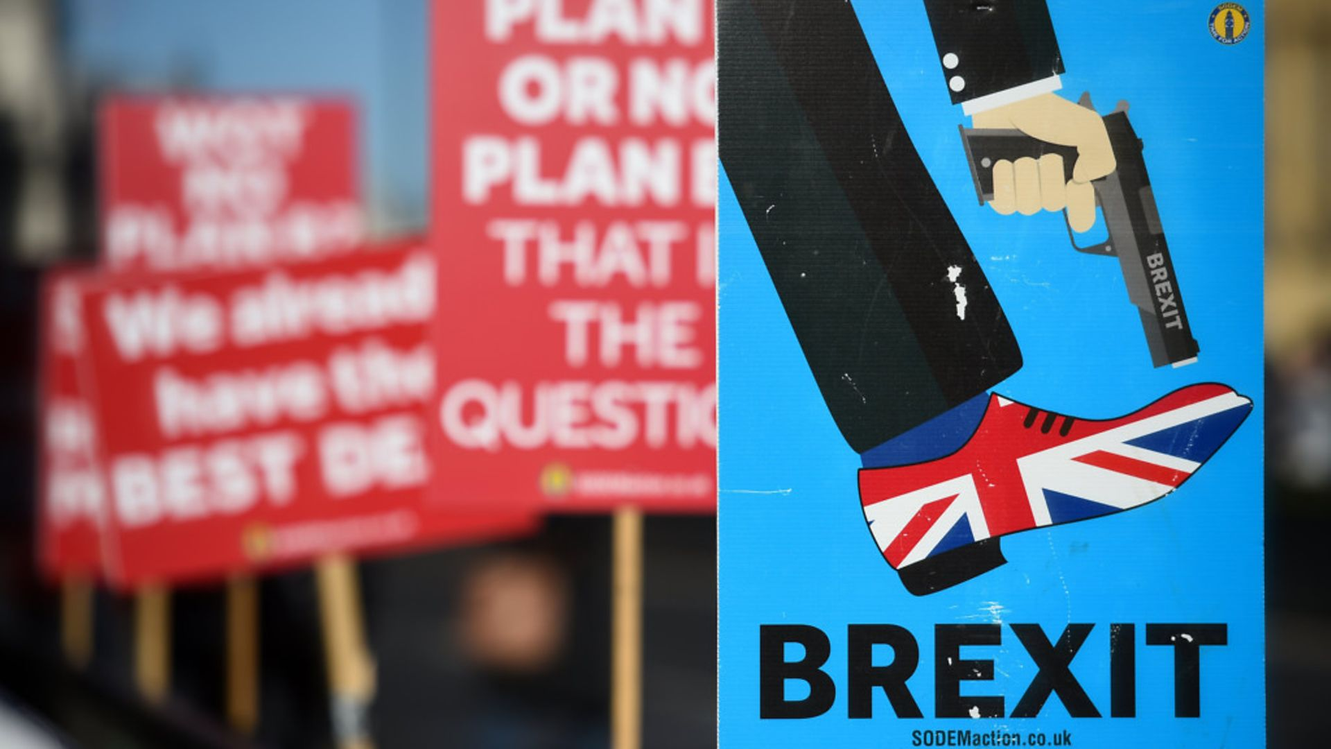 Anti-Brexit campaigners' placards outside the Houses of Parliament - Credit: PA Wire/PA Images