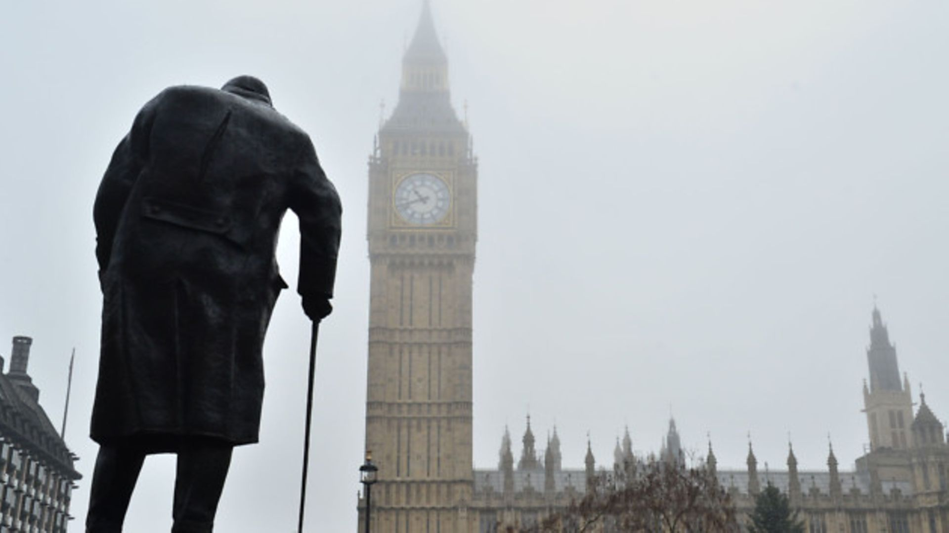 The statue of Winston Churchill in Parliament Square and the Houses of Parliament - Credit: PA Wire/PA Images
