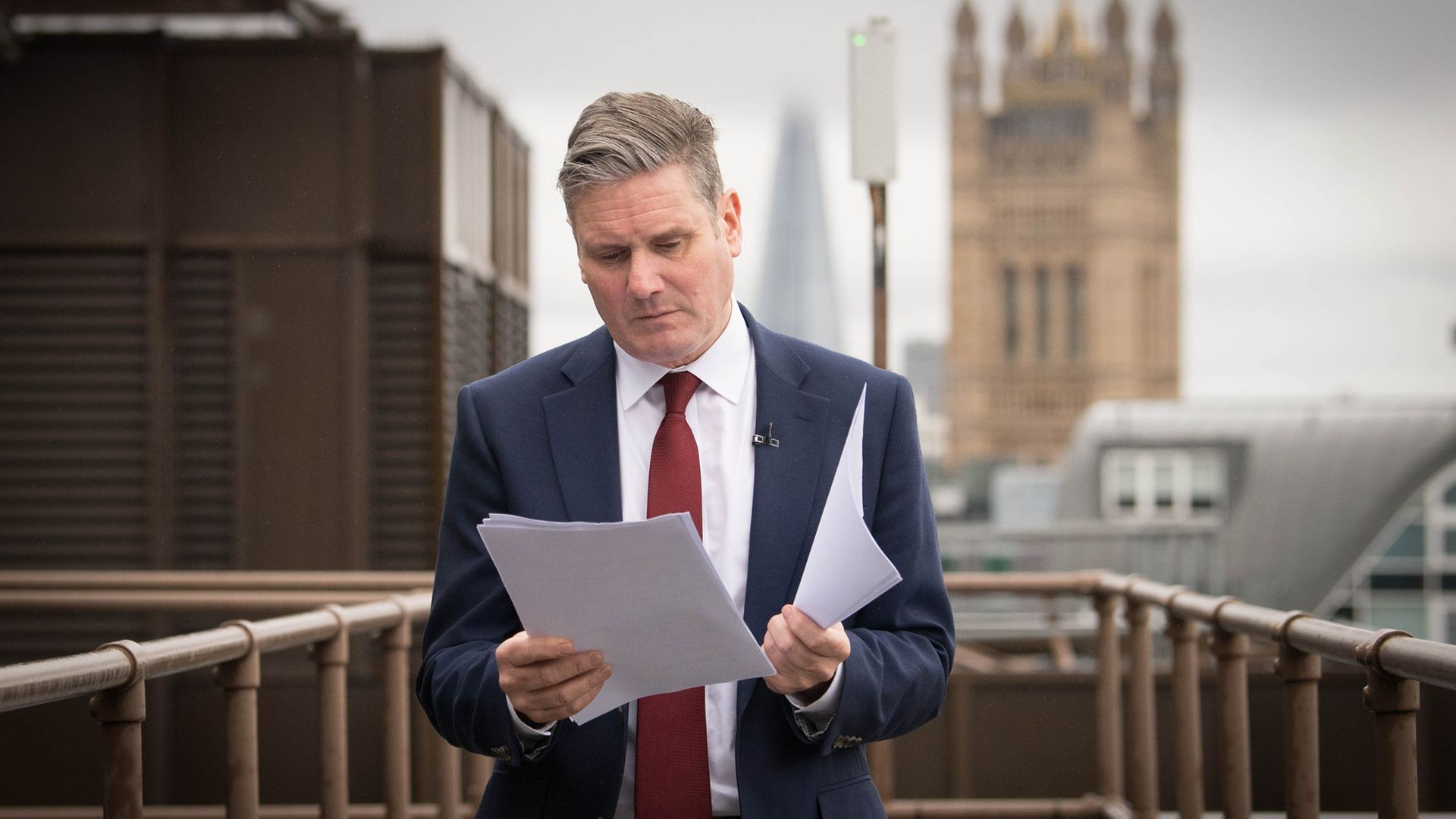 Labour leader Sir Keir Starmer reads through his notes shortly before delivering a virtual speech - Credit: PA