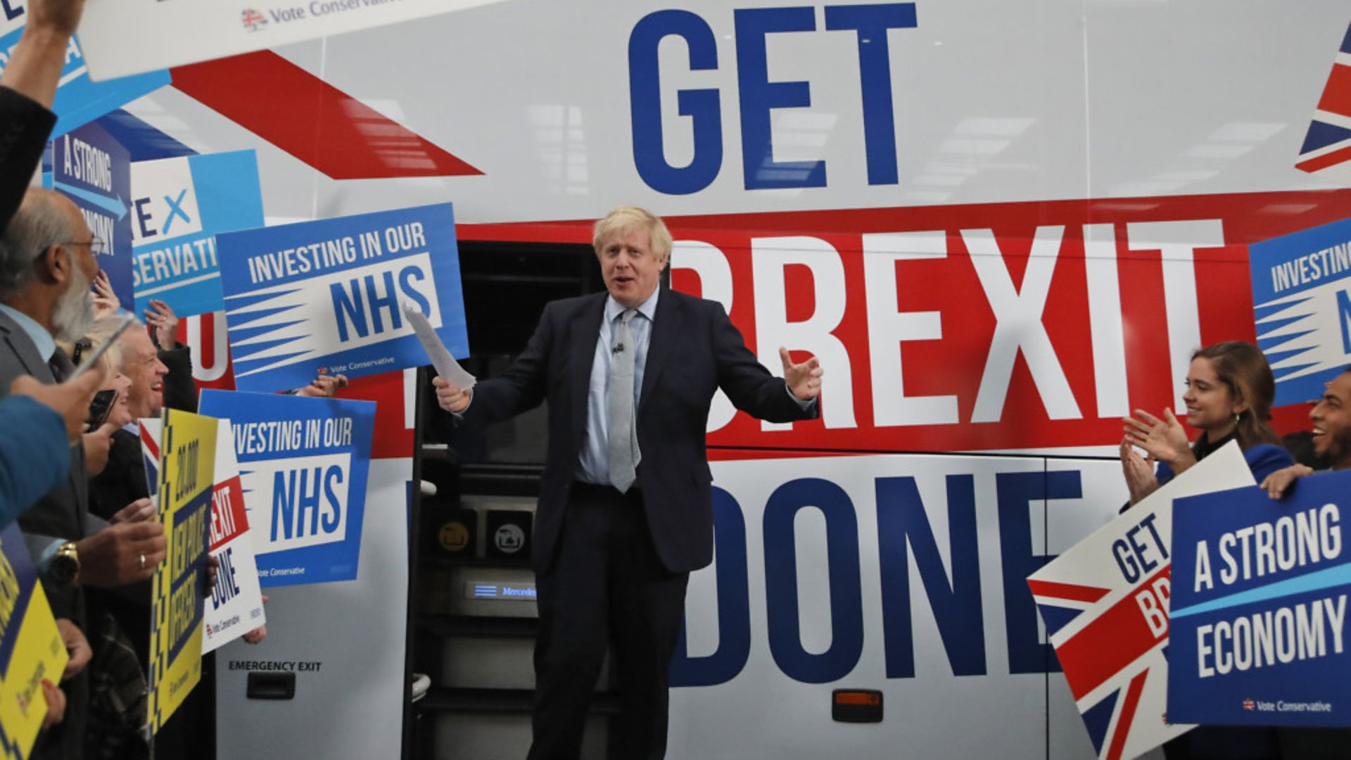Prime Minister Boris Johnson addresses his supporters prior to boarding his general election campaign bus in Manchester - Credit: Getty Images