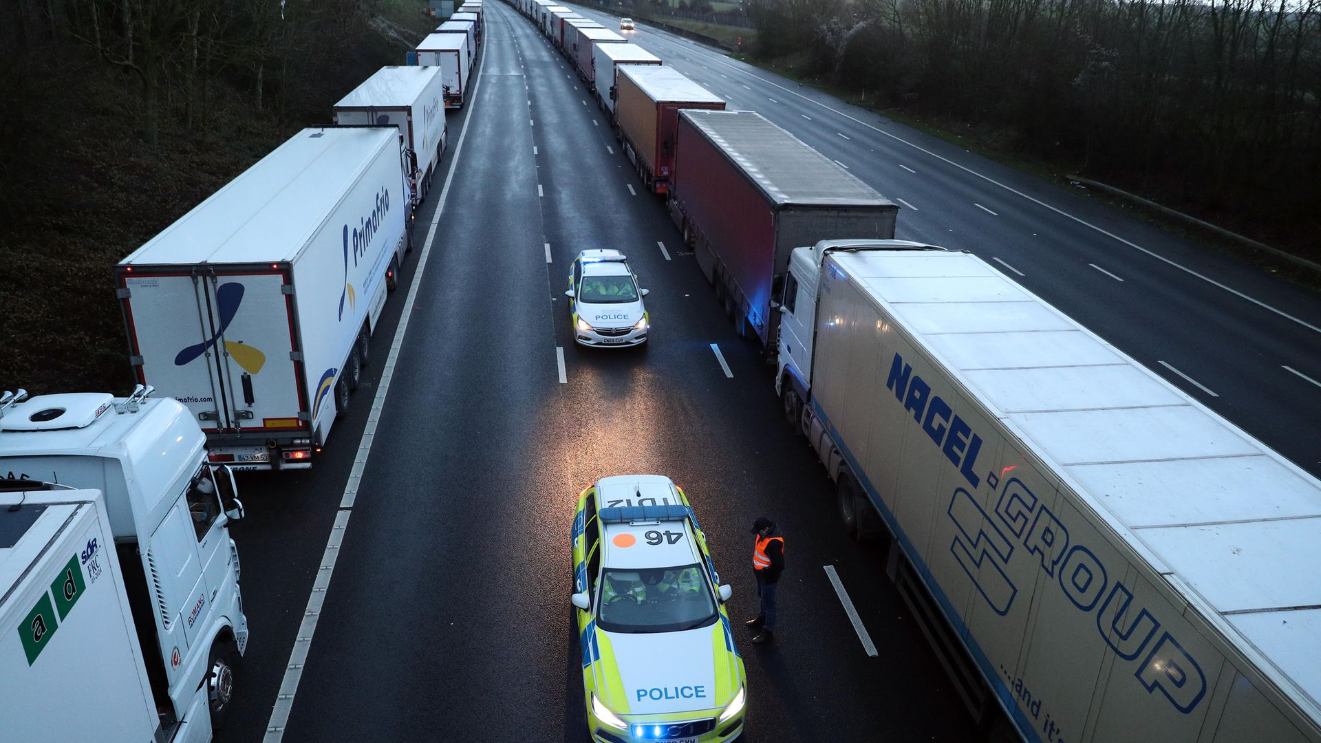 Lorries queue along the M25 in Kent. - Credit: PA