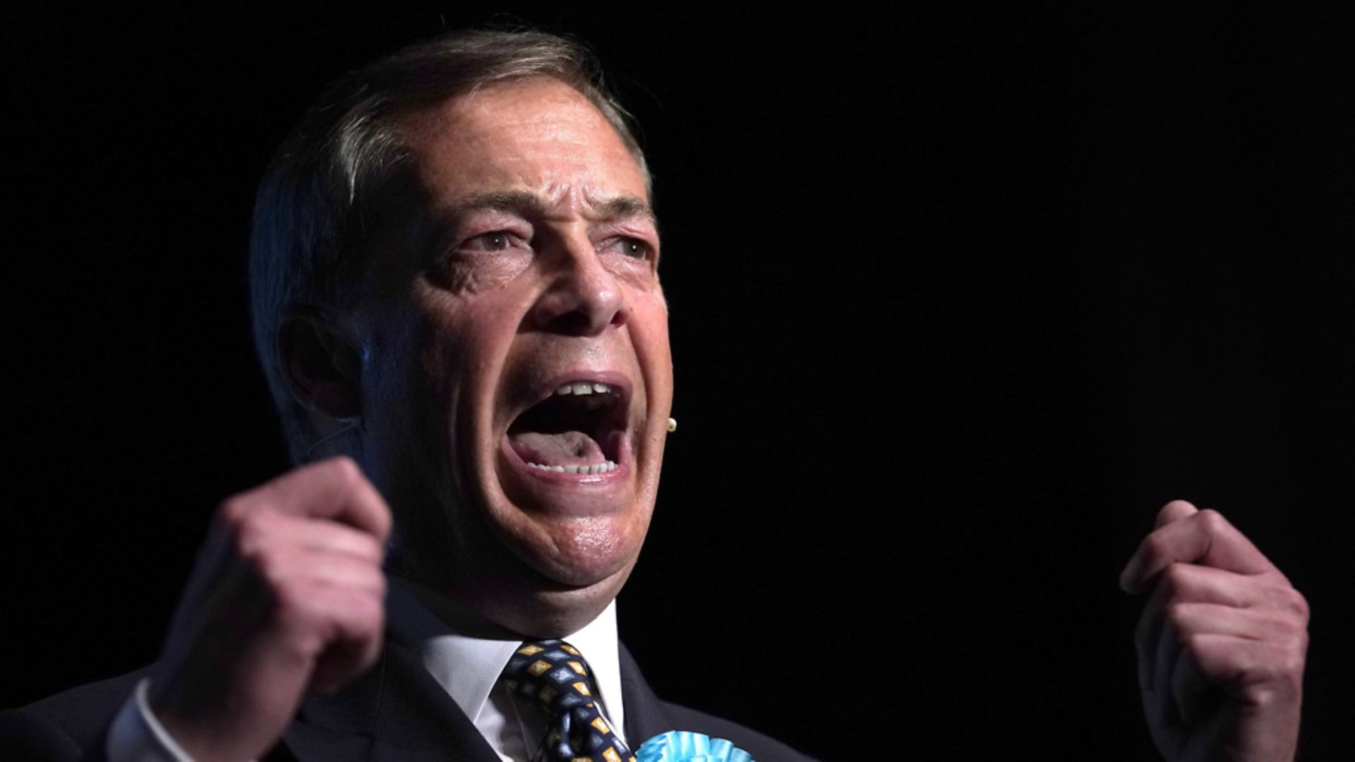 Brexit Party's Nigel Farage addresses supporters during a rally. - Credit: Getty Images