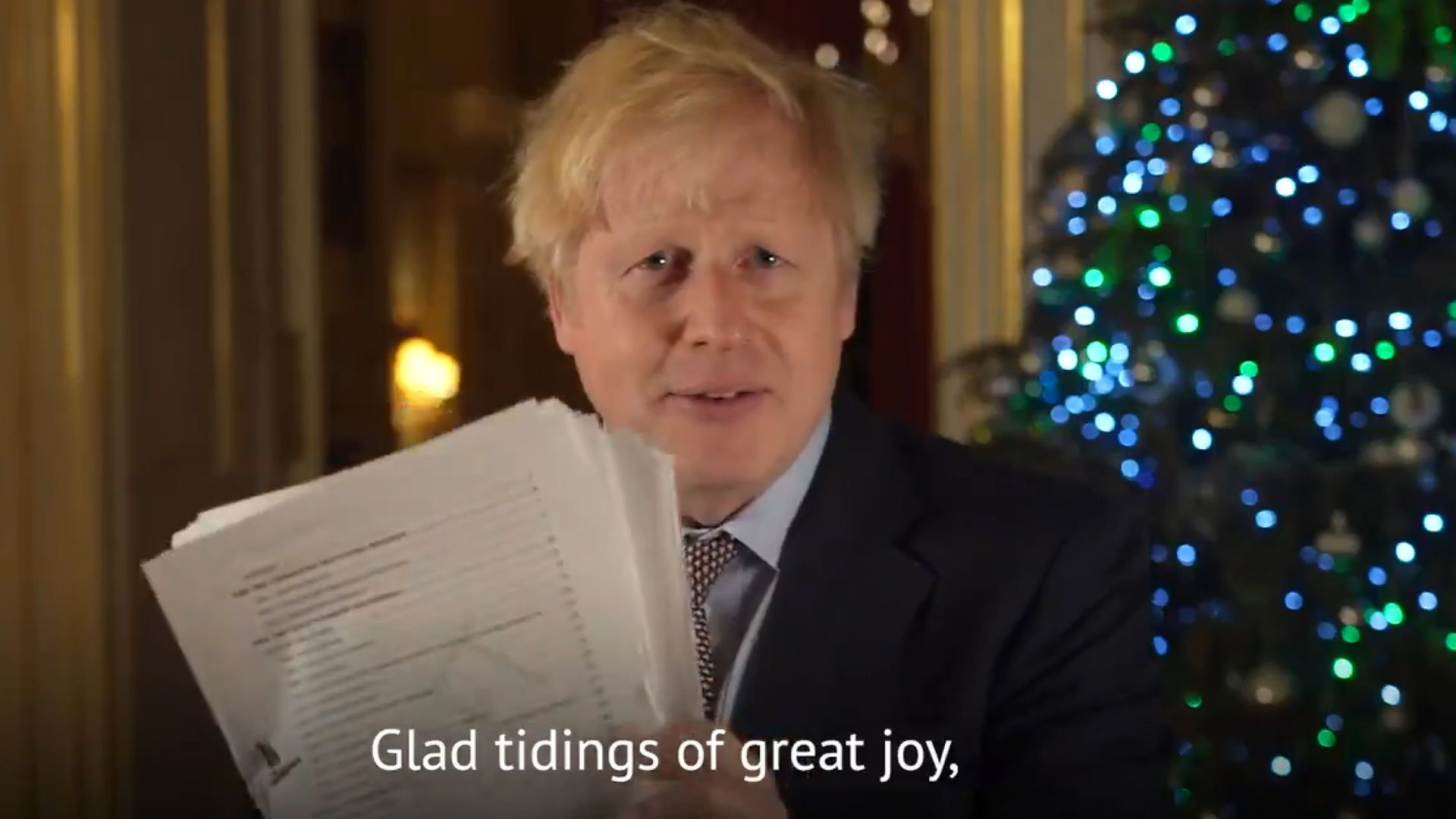 Prime Minister Boris Johnson holding up a document believed to be the pages of the Brexit deal during his Christmas message - Credit: PA