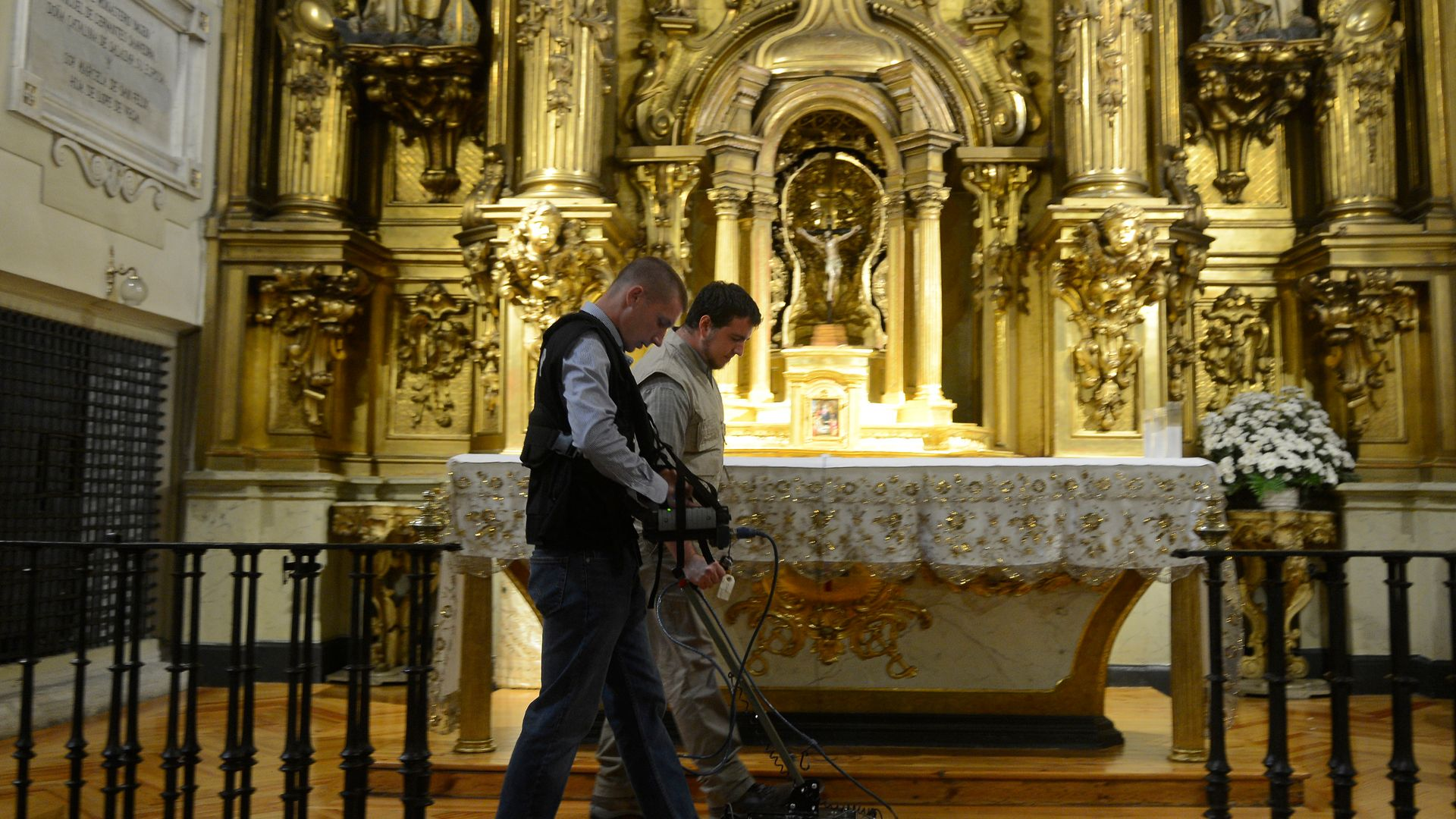 Two operators search for the remains of Miguel de Cervantes at the Convent of the Barefoot Trinitarians in Madrid in 2014. The same team are involved in the latest search - Credit: Getty Images