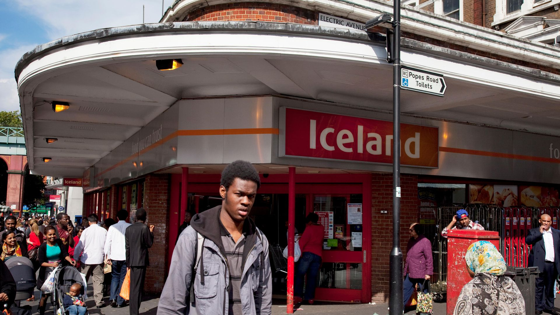 The Iceland supermarket on the corner of Electric Avenue, where Will Self's artwork is displayed - Credit: Corbis via Getty Images