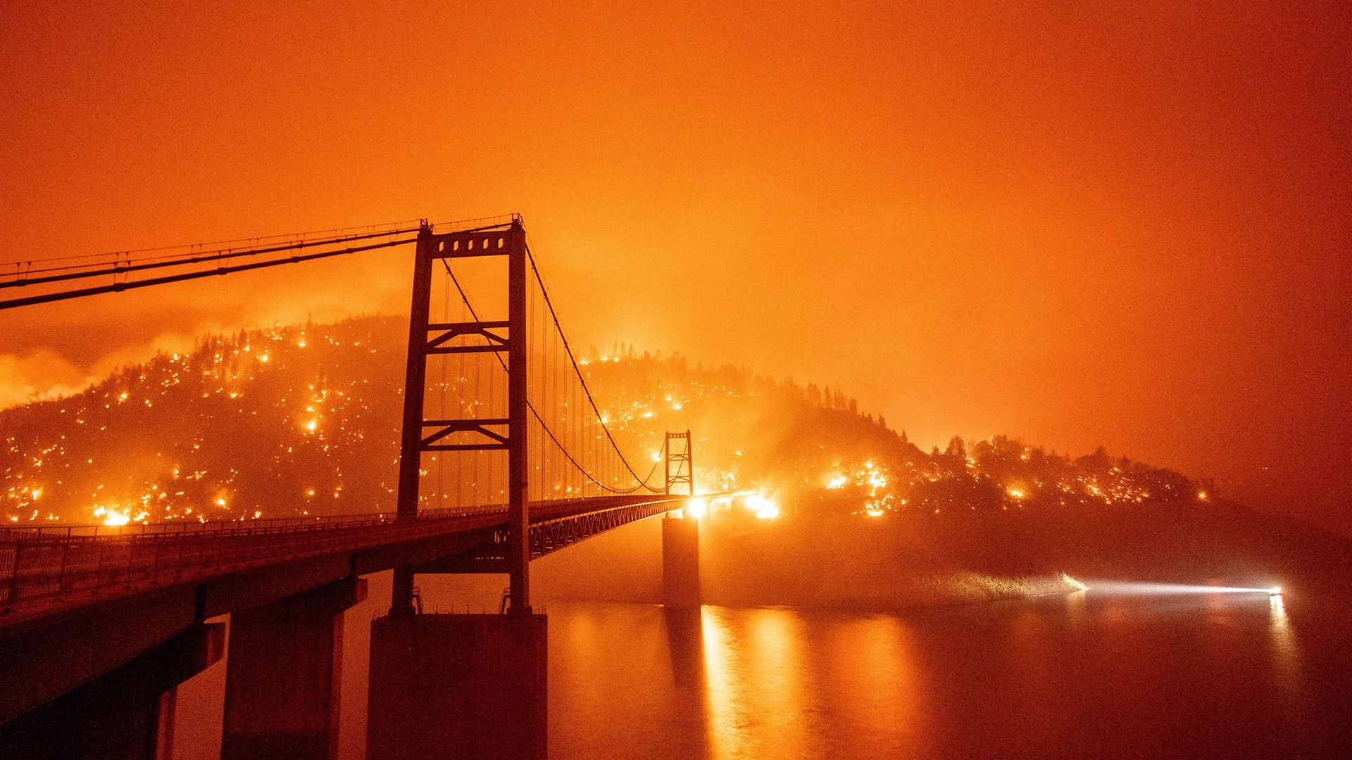 The Bidwell Bar Bridge over Lake Oroville, California, during forest fires in September 2020 - Credit: AFP via Getty Images