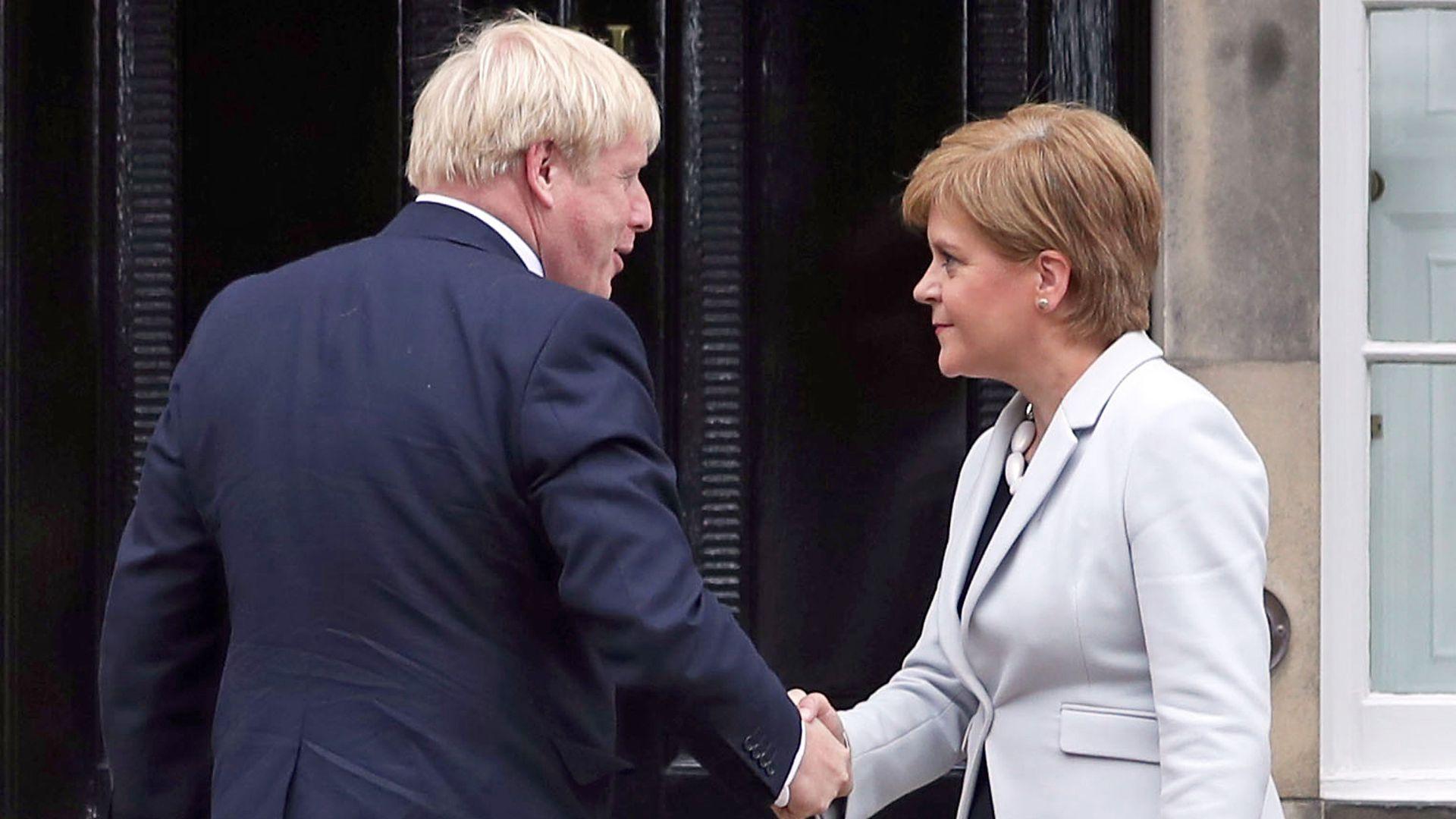 Scotland's first minister Nicola Sturgeon welcoming prime minister Boris Johnson outside Bute House in Edinburgh - Credit: PA