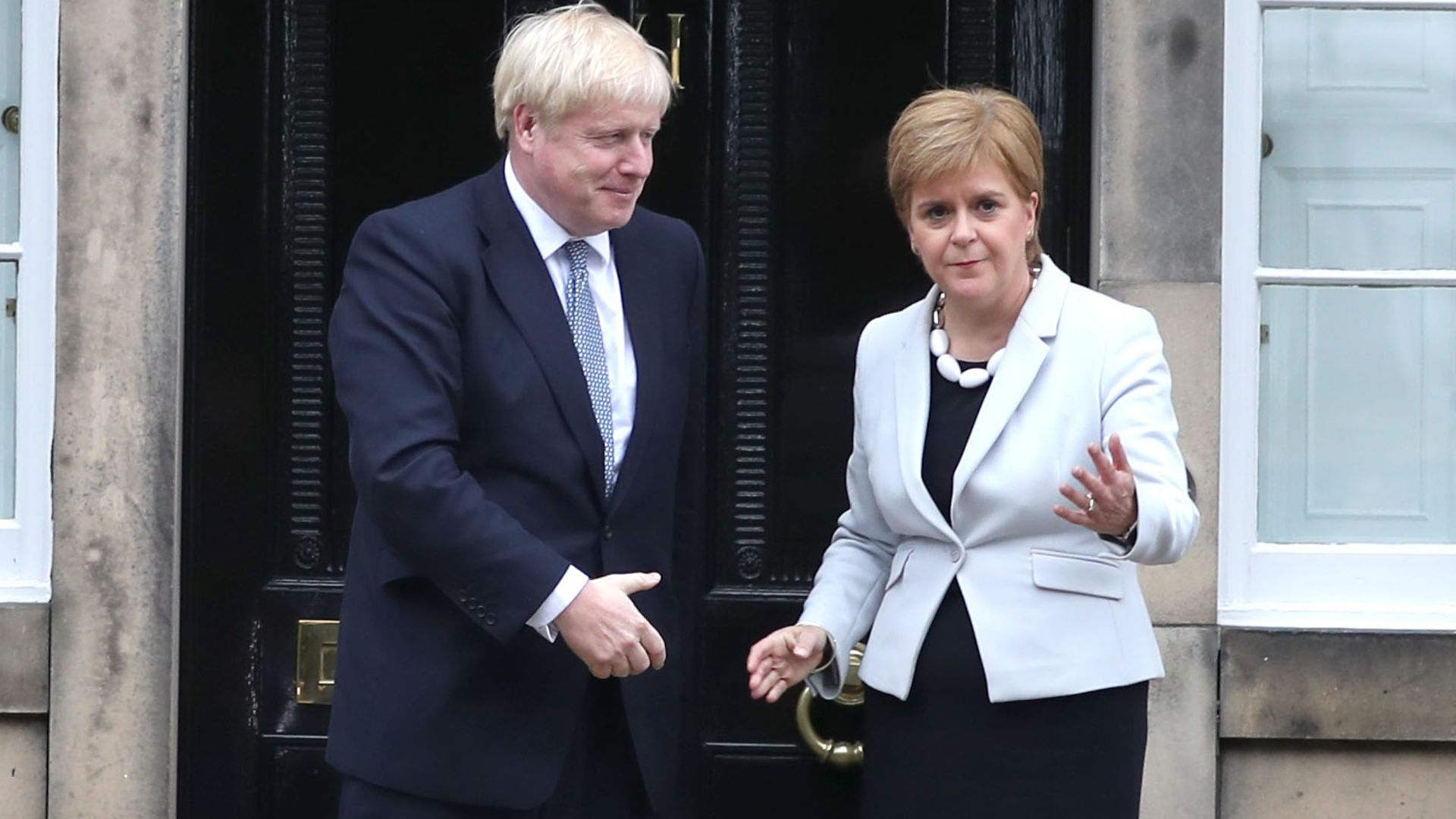Scotland's first minister Nicola Sturgeon welcomes prime minister Boris Johnson outside Bute House in Edinburgh ahead of their meeting - Credit: PA