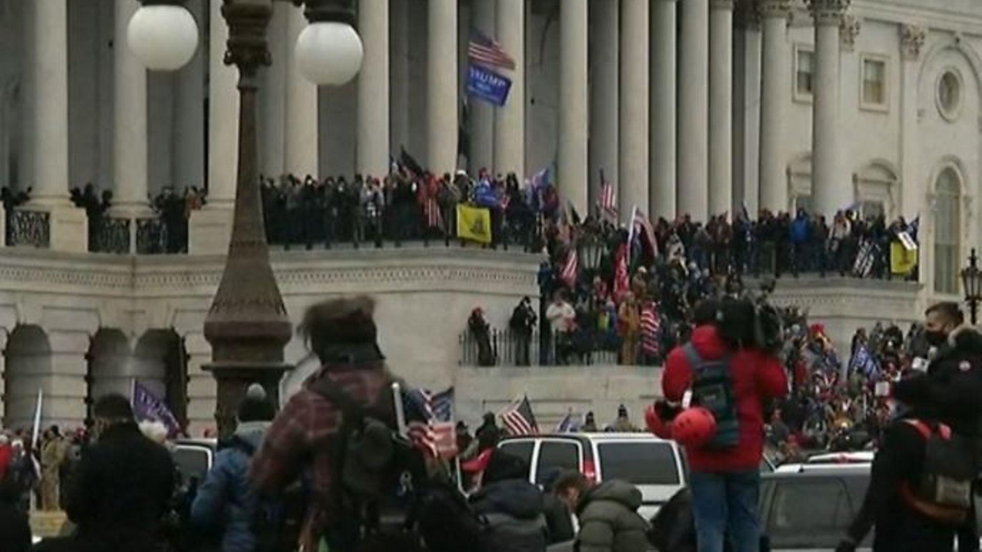 Trump protesters storming Capitol Hill - Credit: BBC