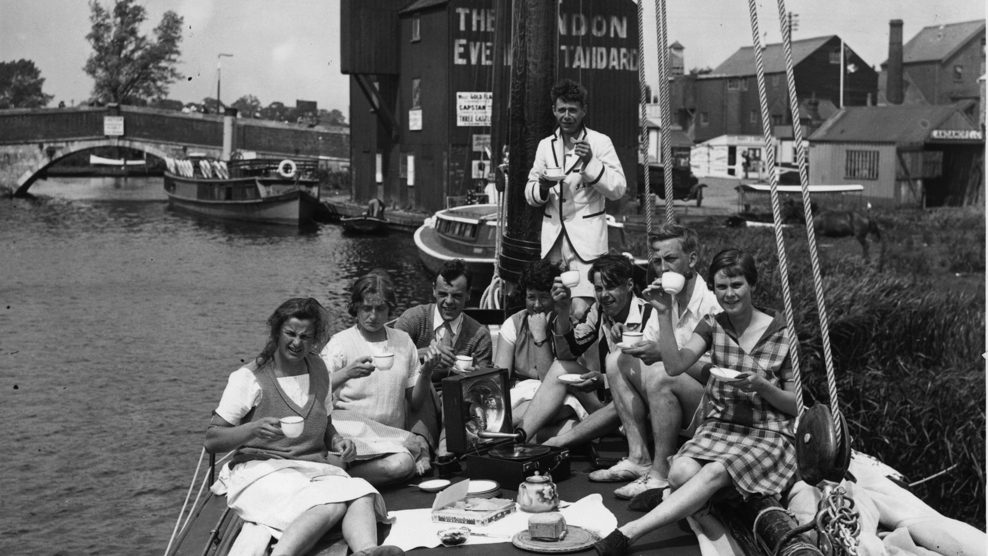Messing about in 'boots' - holidaymakers relax on board their vessel in Peter's native Norfolk in 1926 - Credit: Getty Images