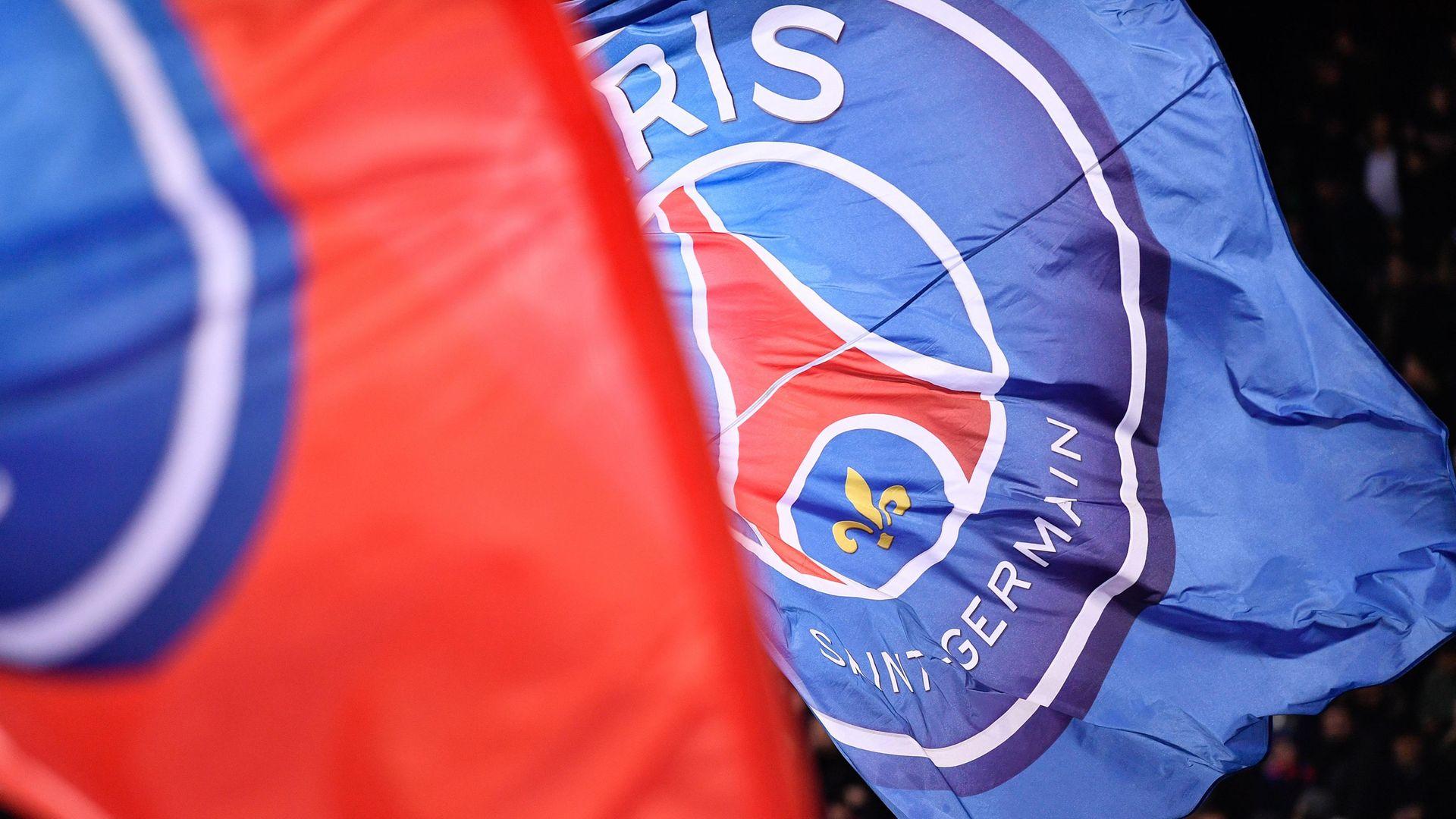 The Paris Saint-Germain flags wave at the Parc des Princes stadium (question three) - Credit: Julien Mattia/NurPhoto via Getty Images