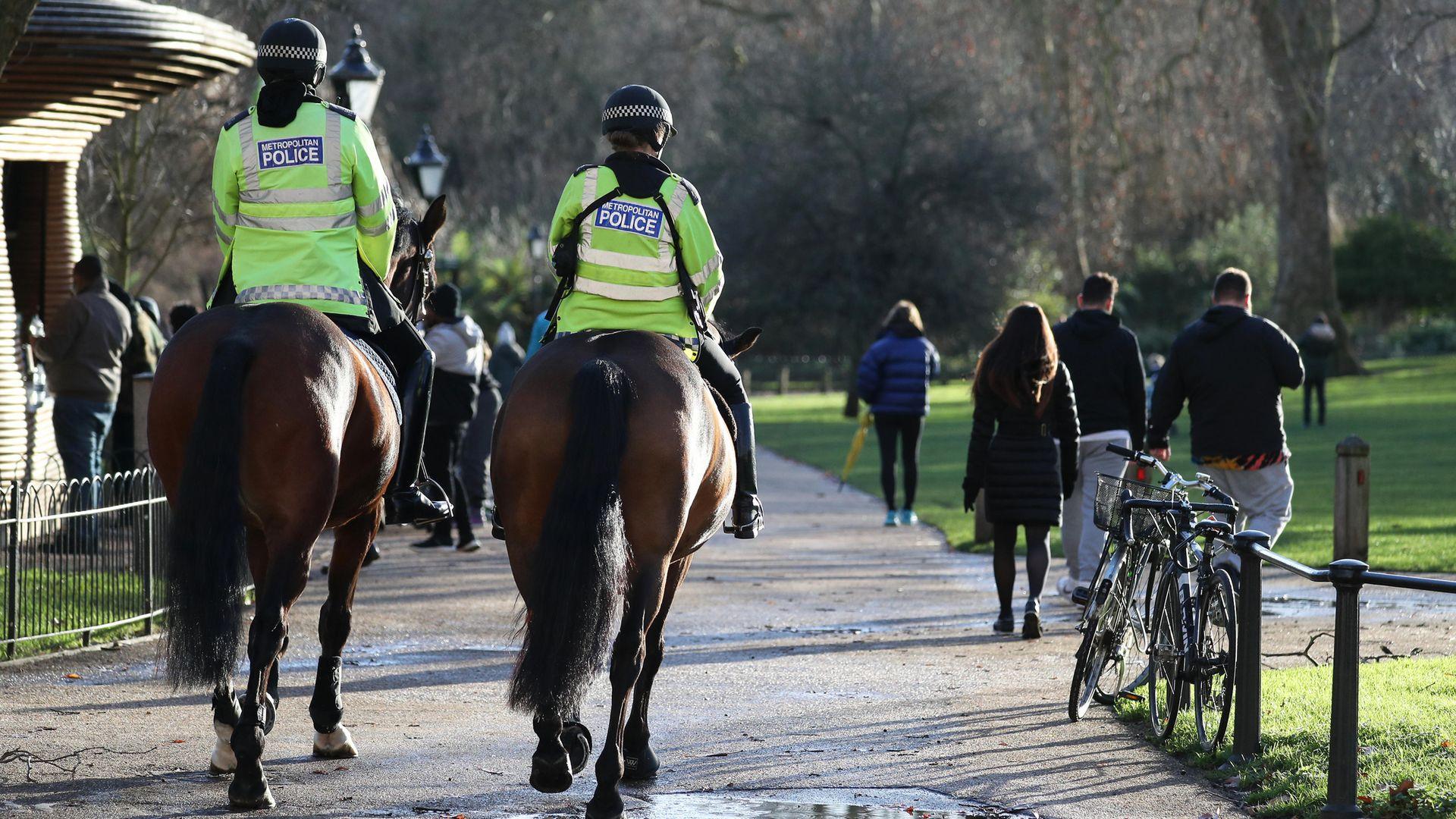 Police patrol on horseback through St James' Park in London. - Credit: PA