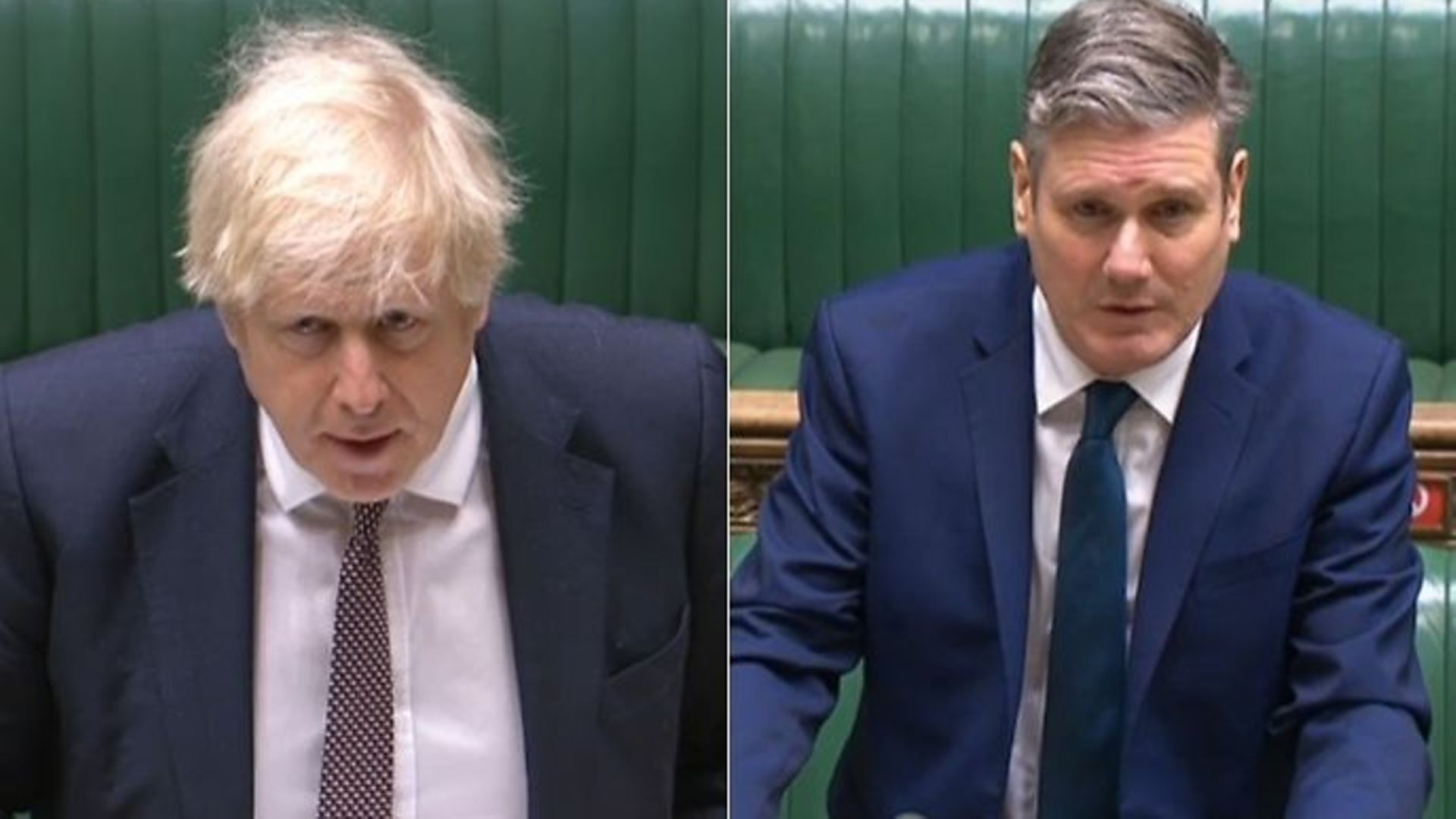 Boris Johnson (L) and Sir Keir Starmer during a session of Prime Minister's Questions (PMQs) - Credit: Parliamentlive.tv