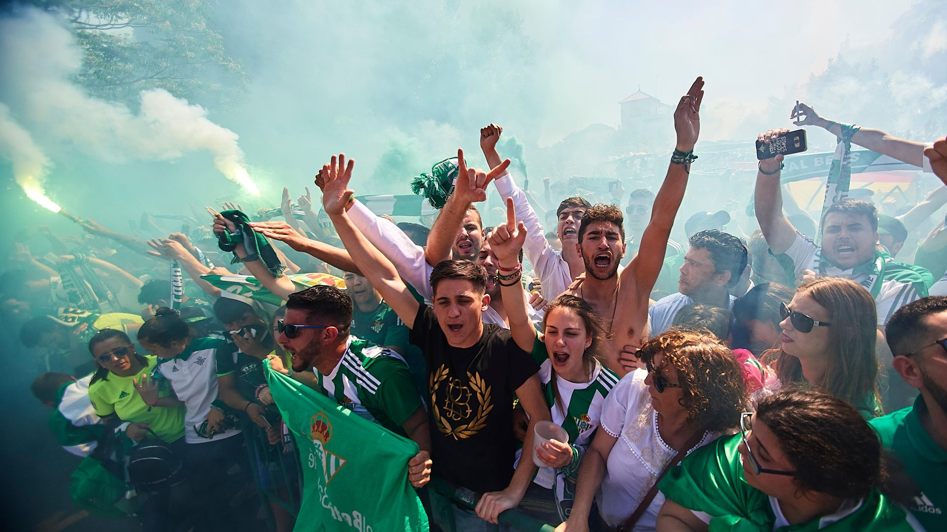 Fans of Real Betis support their team as it arrives at the stadium for a game against local rivals Sevilla in 2018 - Credit: Getty Images