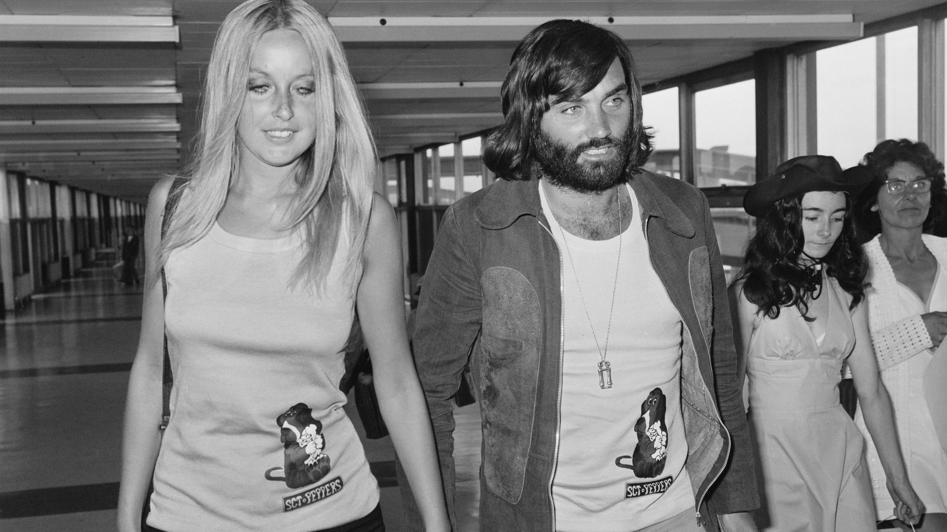 George Best with girlfriend, Swedish actress and model Mary Stavin, at Heathrow Airport in 1973, the year before he signed for South Africa's Jewish Guild - Credit: Getty Images