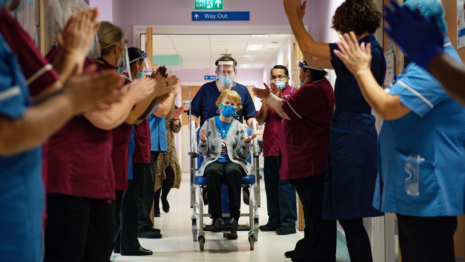 Margaret Keenan, 90, is applauded by staff as she returns to her ward after becoming the first person in the United Kingdom to receive the Pfizer/BioNtech covid-19 vaccine at University Hospital, Coventry, at the start of the largest ever immunisation programme in the UK's history. - Credit: PA