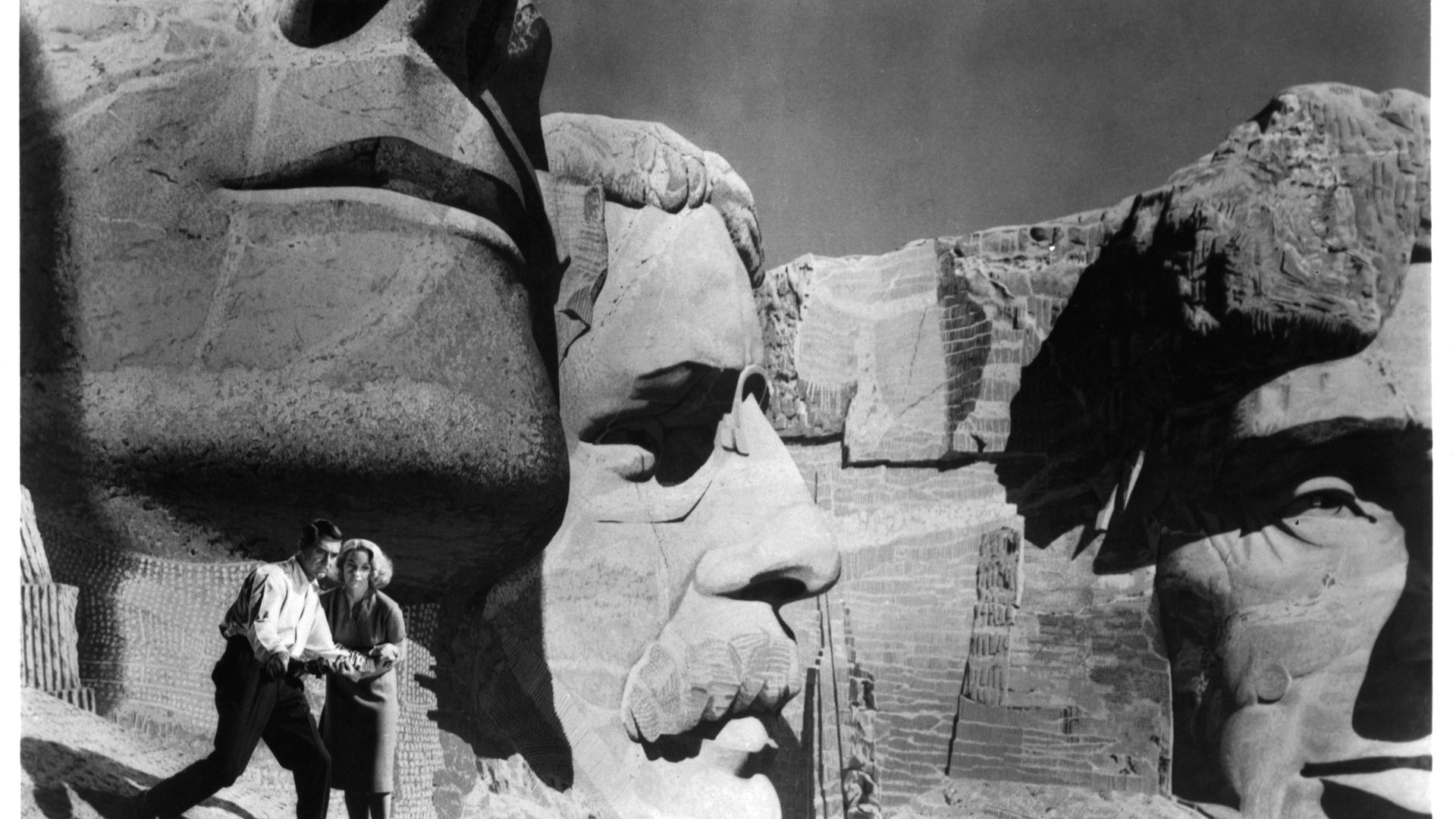Cary Grant and Eva Marie Saint walking near the faces on Mt. Rushmore in a scene from the film North By Northwest, 1959 - Credit: Getty Images