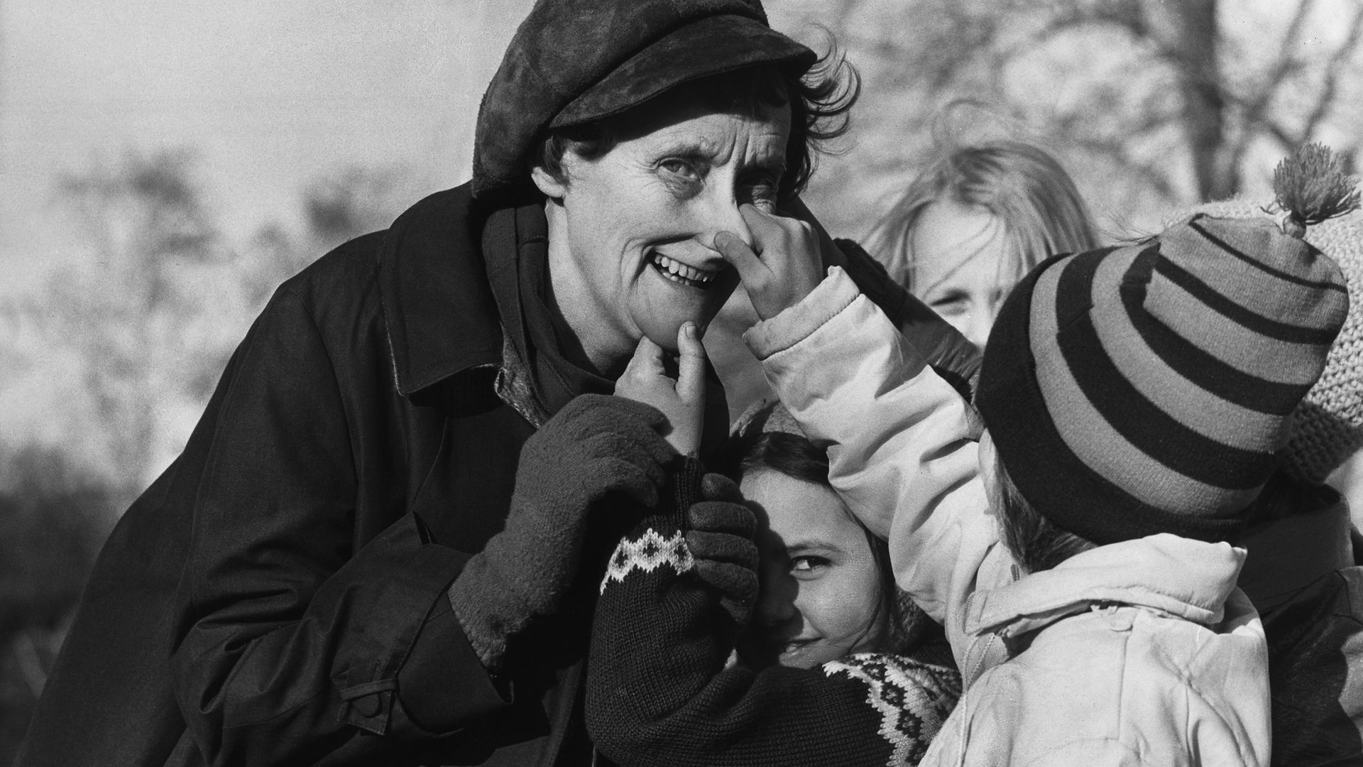 Author Astrid Lindgren has her nose pulled by a young fan - Credit: ullstein bild via Getty Images
