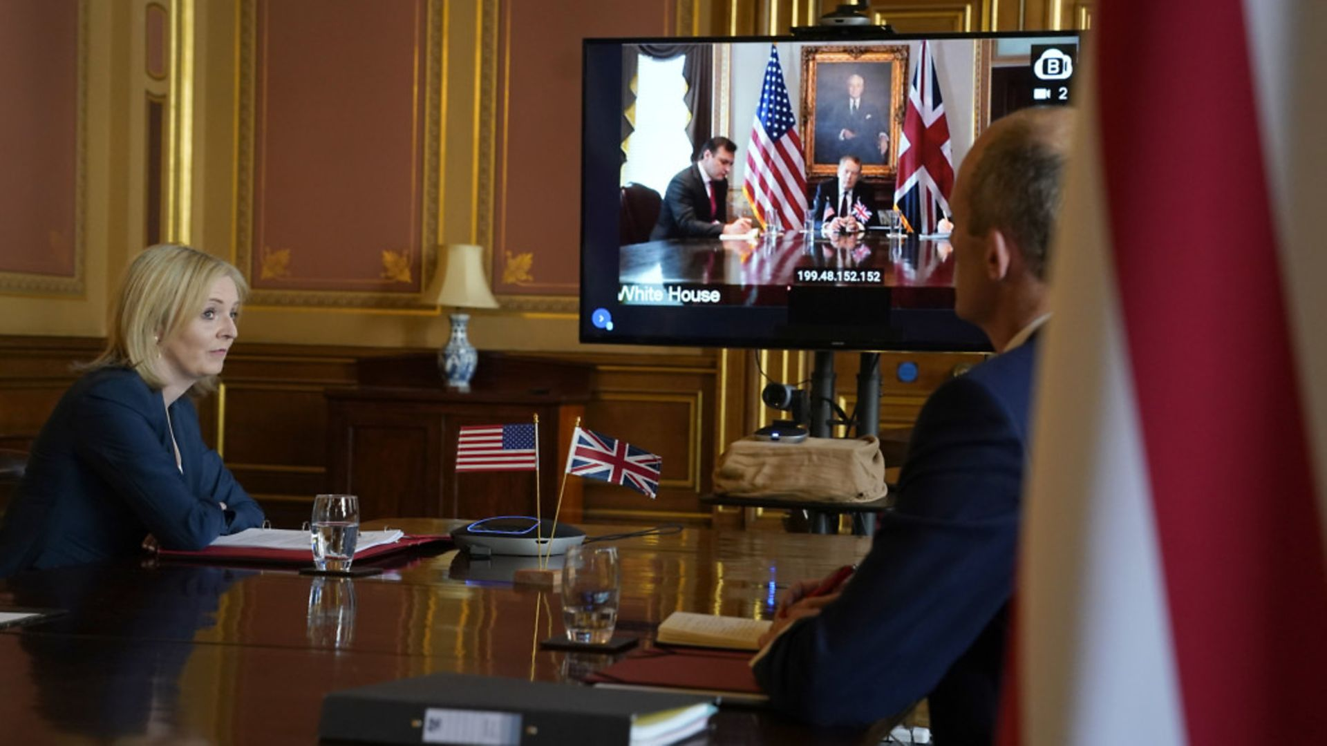 International Trade Secretary Liz Truss and the US trade representative Robert Lighthizer (on screen) as they formally begin the UK-US trade talks during a video conference call - Credit: Andrew Parsons/10 Downing Street/Crown Copyright/PA Wire