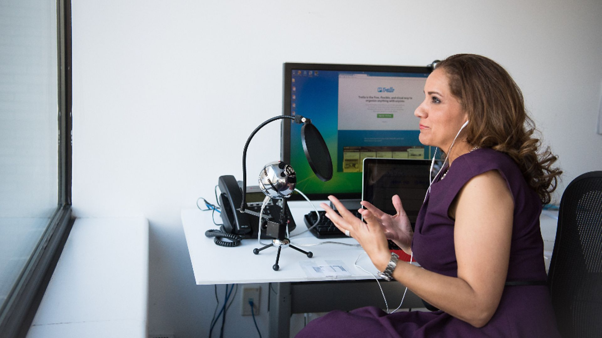 A woman recording a podcast - Credit: Stocksnap
