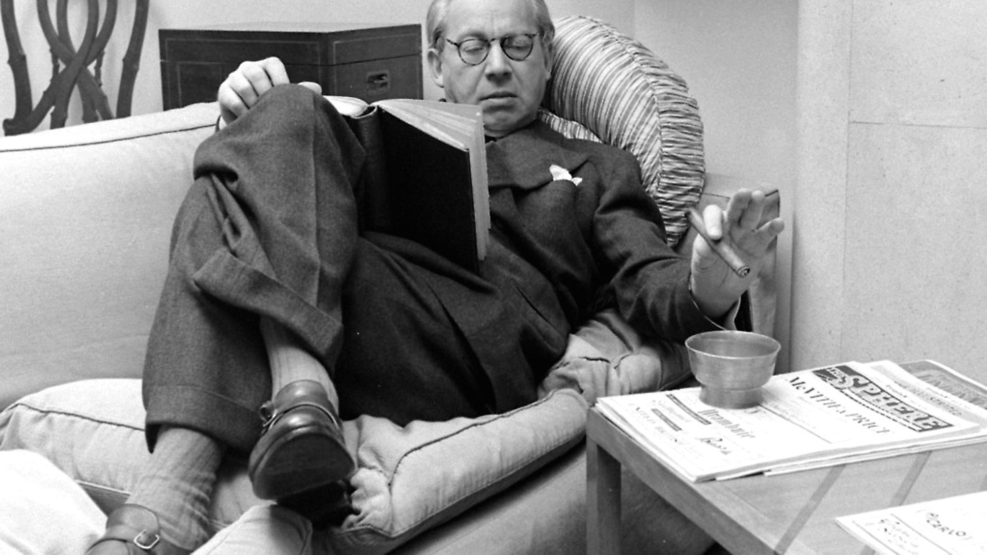 Sir Alexander Korda reading a book on a couch, United Kingdom, 1948 (Photo by Nat Farbman/The LIFE Picture Collection via Getty Images) - Credit: The LIFE Picture Collection via