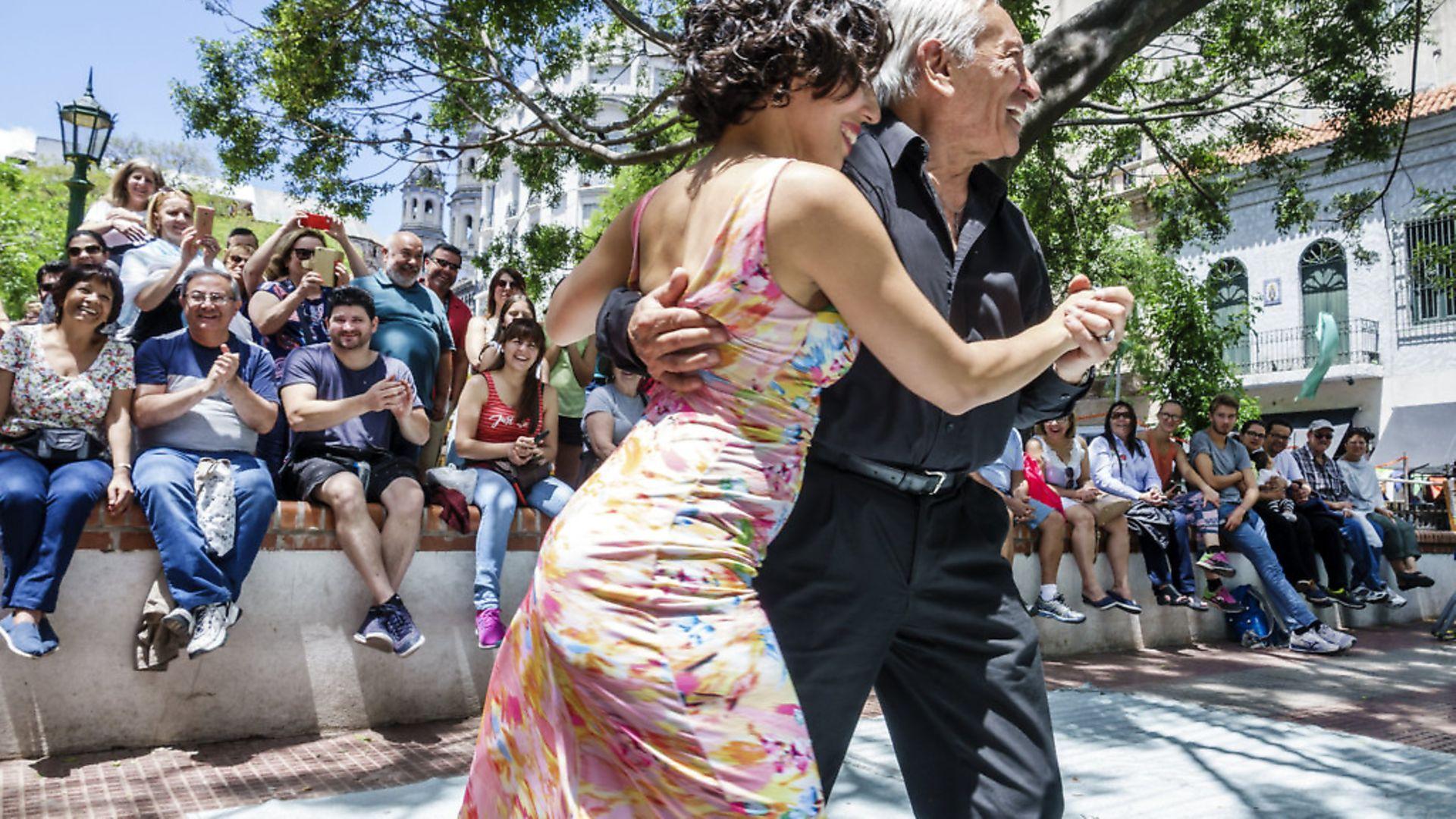 Tango dancers performing at San Telmo Plaza Dorrego. Photo: Jeffrey Greenberg/Universal Images Group via Getty Images - Credit: Universal Images Group via Getty