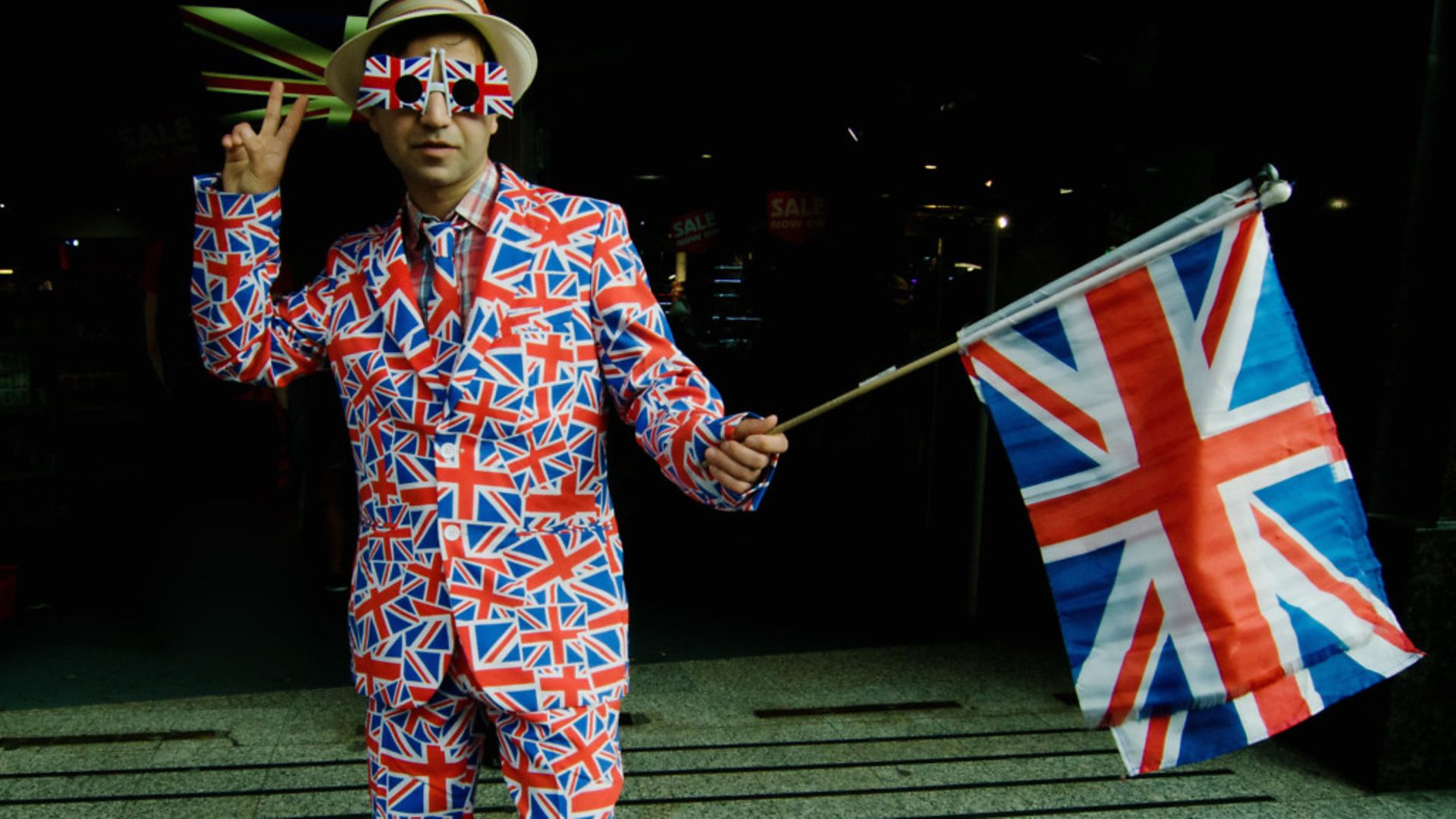 A man wearing a costume in the colors of the United Kingdom flag as Britain voted for Brexit - Credit: PA Images