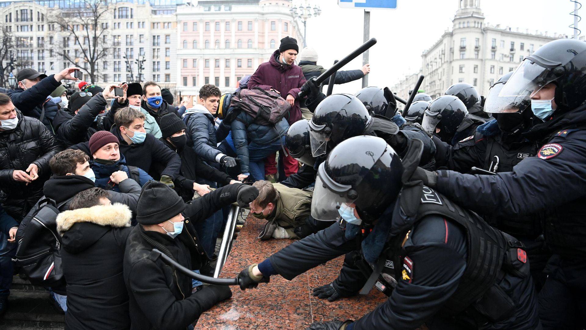 Protesters clash with riot police during a rally in support of jailed opposition leader Alexei Navalny in downtown Moscow - Credit: AFP via Getty Images
