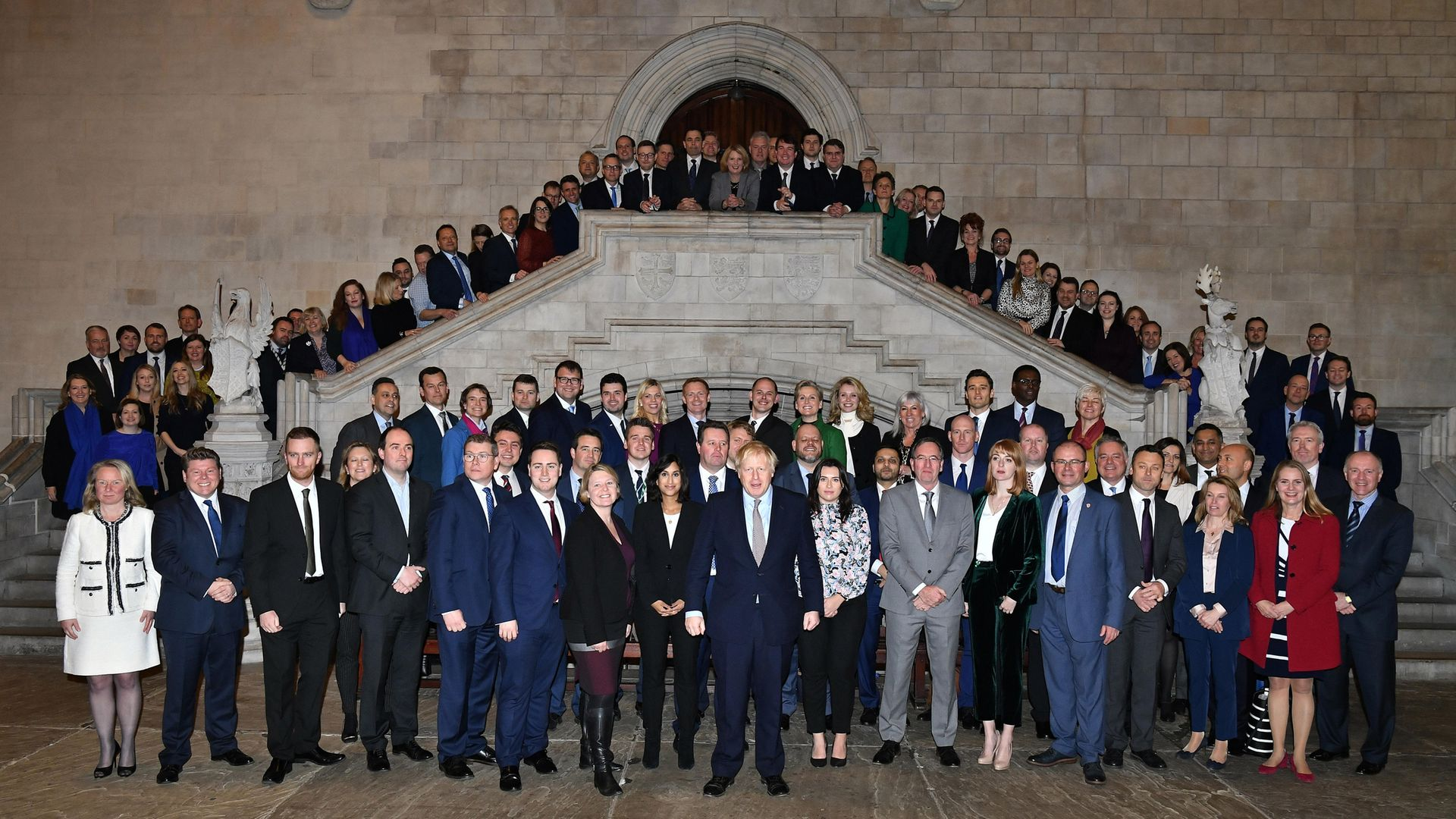 Boris Johnson alongside newly elected Conservative MPs at the Houses of Parliament in Westminster - Credit: PA