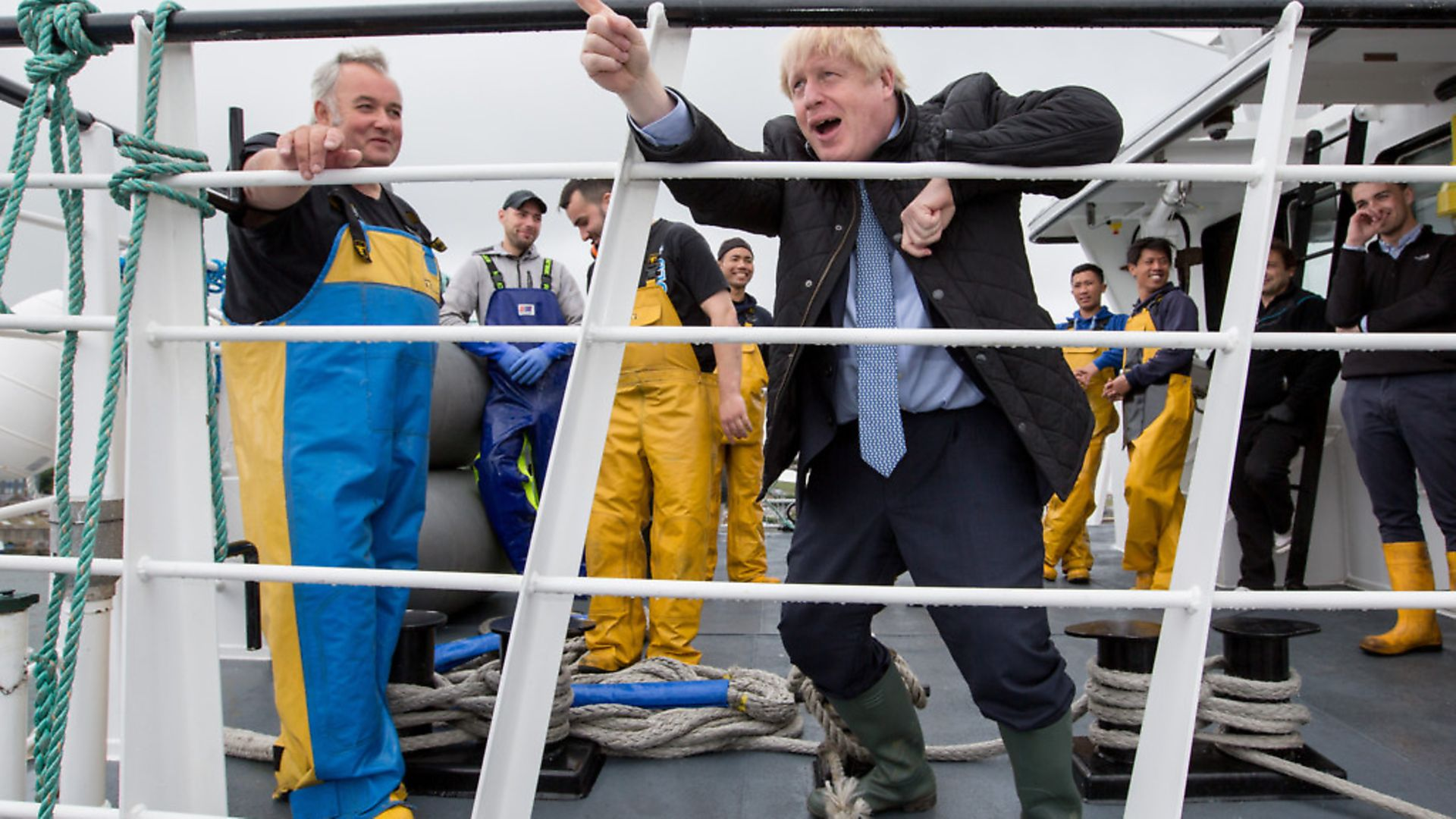 British Prime Minister Boris Johnson speaks to members of the crew on the Carvela at Stromness Harbour, in Scotland. Photo: Robert Perry - WPA Pool/Getty Images) - Credit: Getty Images