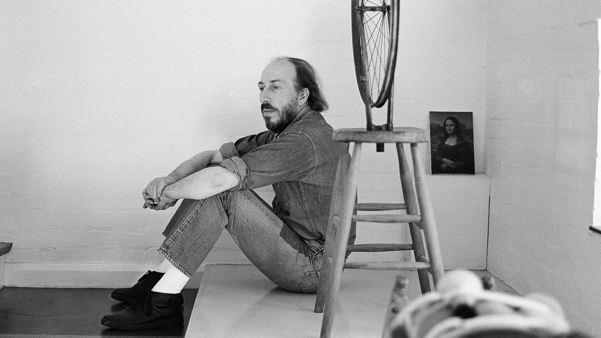 Richard Hamilton seated in his studio at 25 Hurst Avenue in Highgate in London circa 1970 - Credit: Redferns