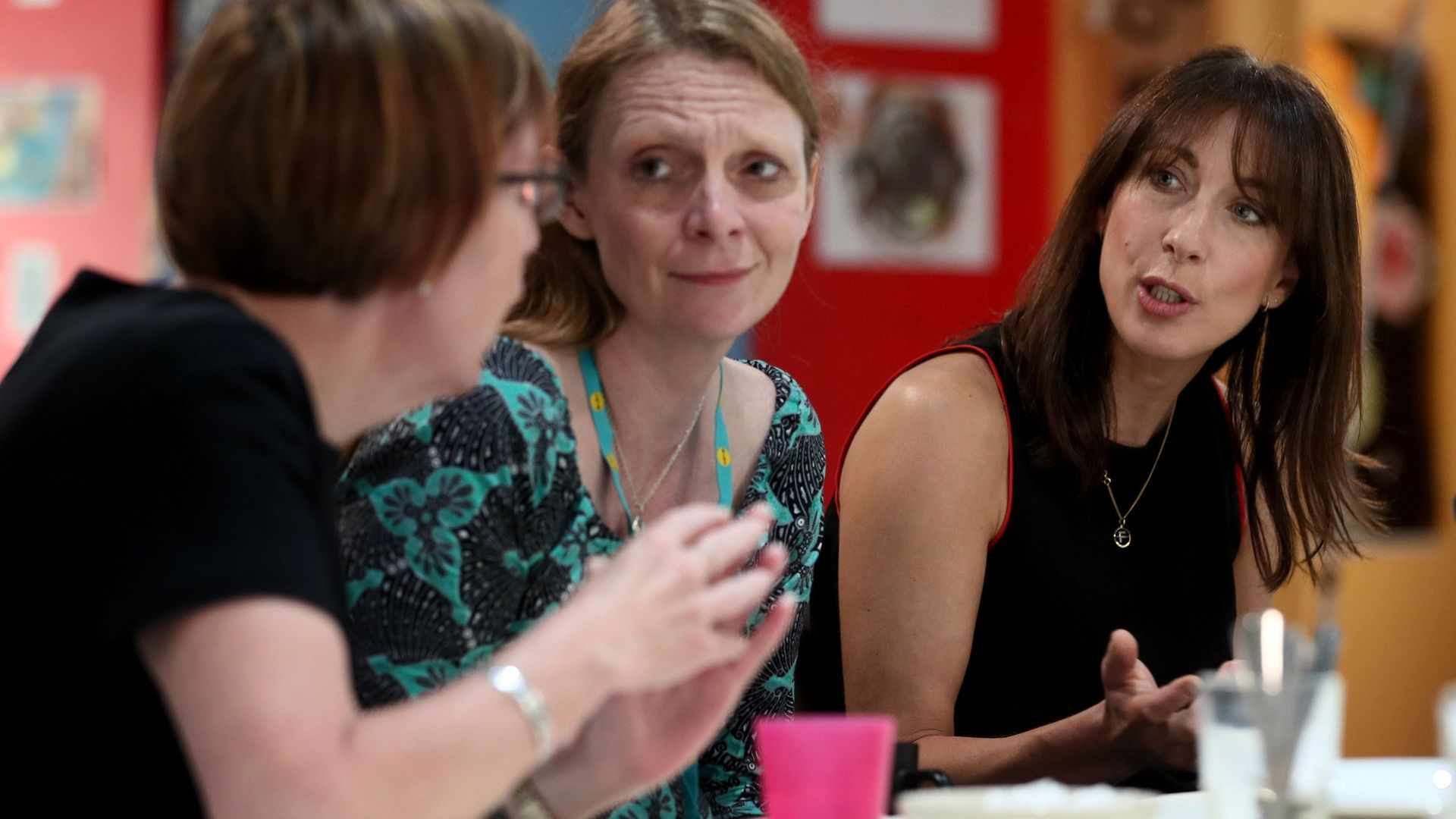 Samantha Cameron (right) hosts a coffee morning to celebrate the work of charity KIDS and the services that they deliver to disabled children, young people and their families, at Hackney Adventure Playground in London. - Credit: PA