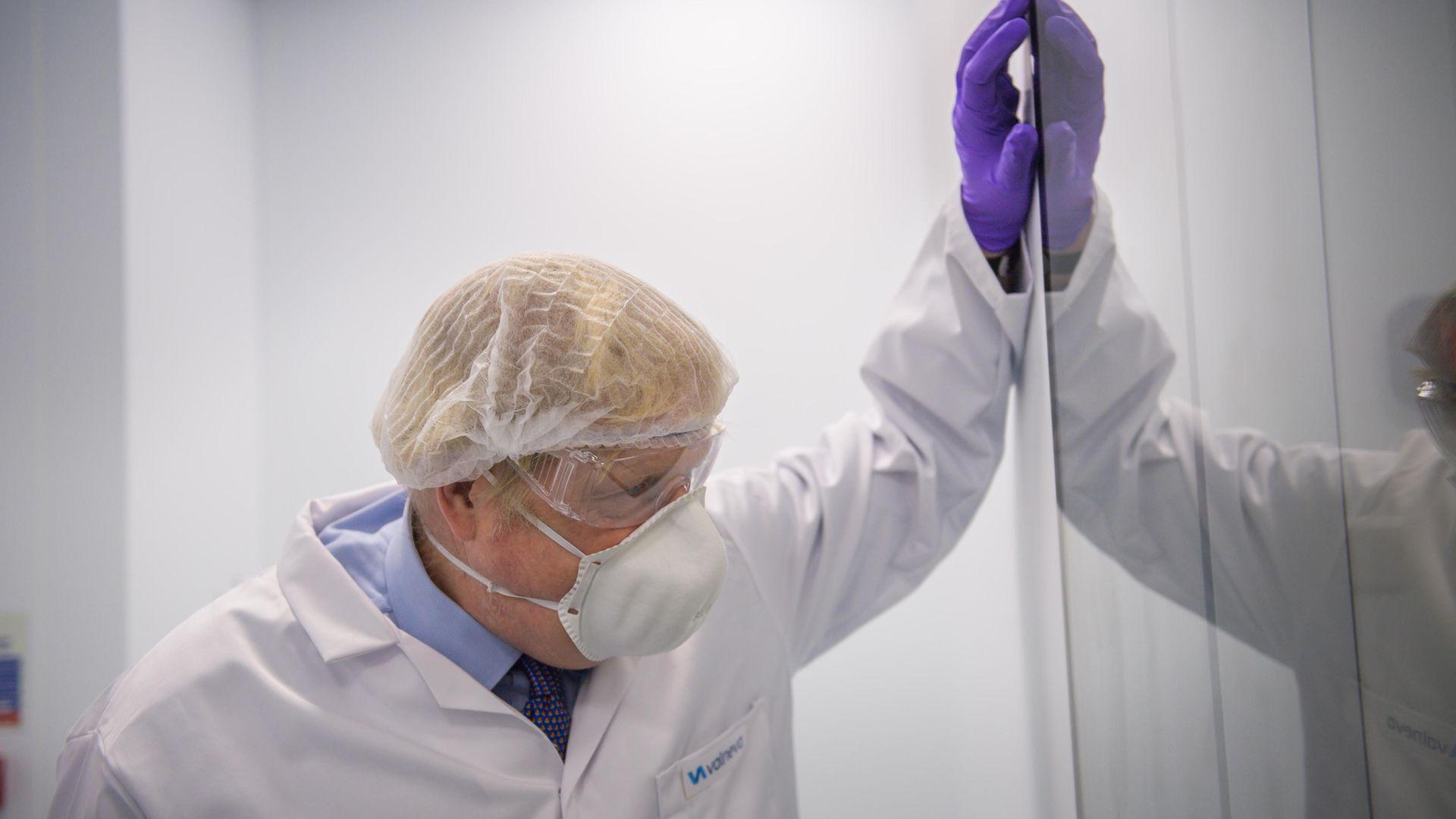 Prime Minister Boris Johnson visiting the French biotechnology laboratory Valneva in Livingston - Credit: PA