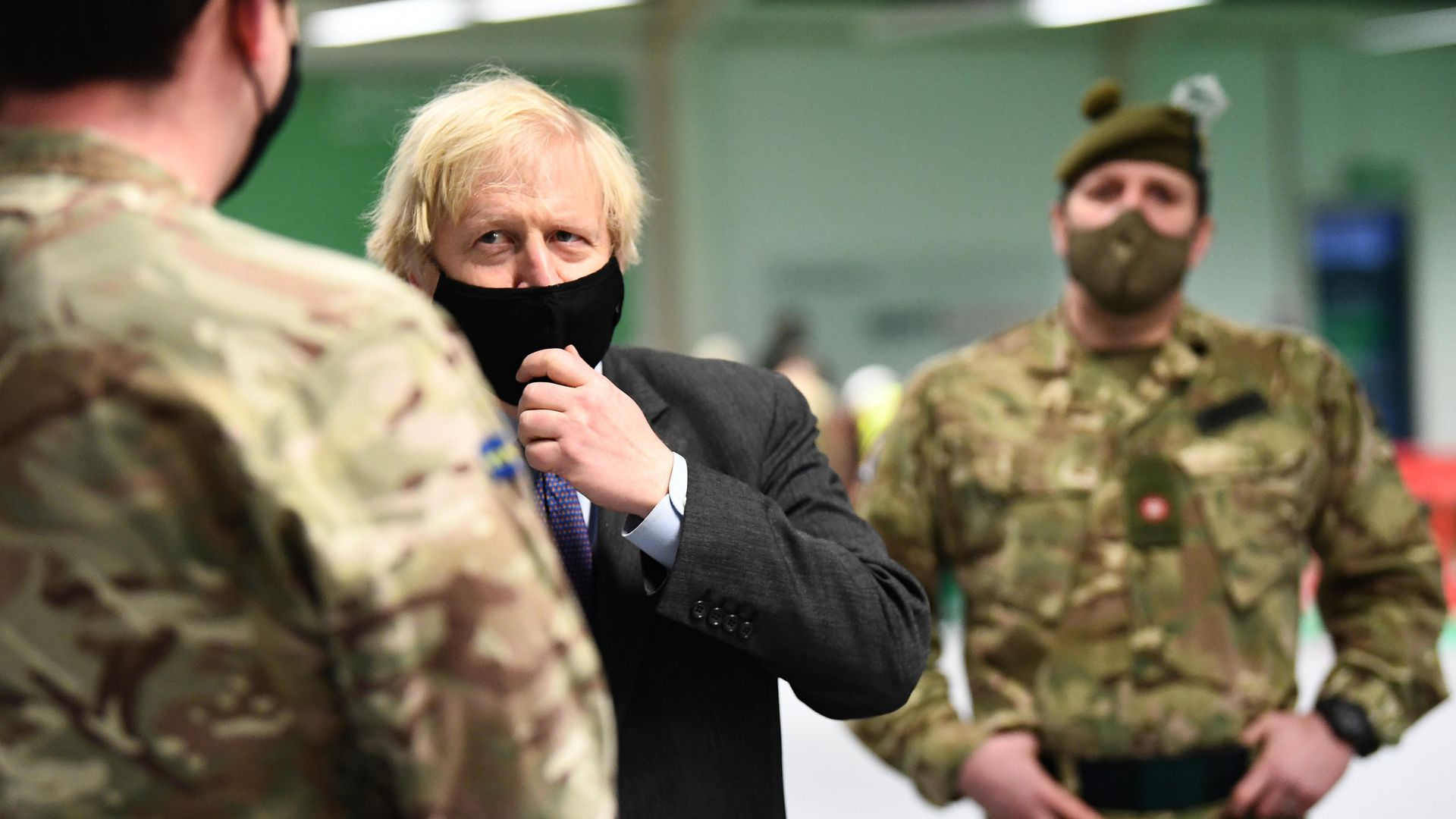 Prime minister Boris Johnson meets troops setting up a vaccination centre in the Castlemilk district of Glasgow on his one day visit to Scotland - Credit: PA