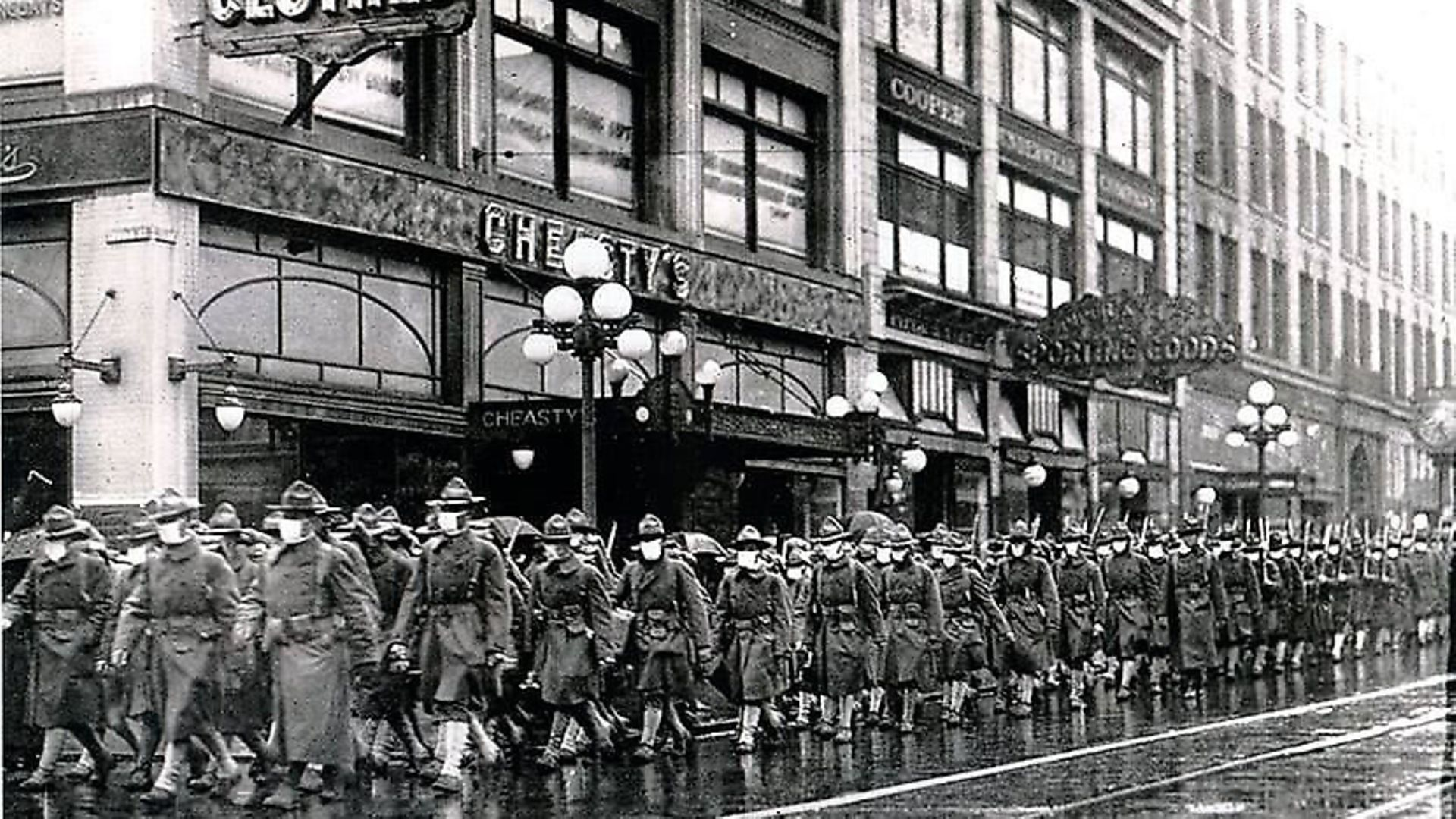 The 39th Regiment, wearing masks to protect soldiers from the flu virus, marches through the streets of Seattle in December 1918 Photo: ©Atlas Archive / The Image Works. - Credit: Archant