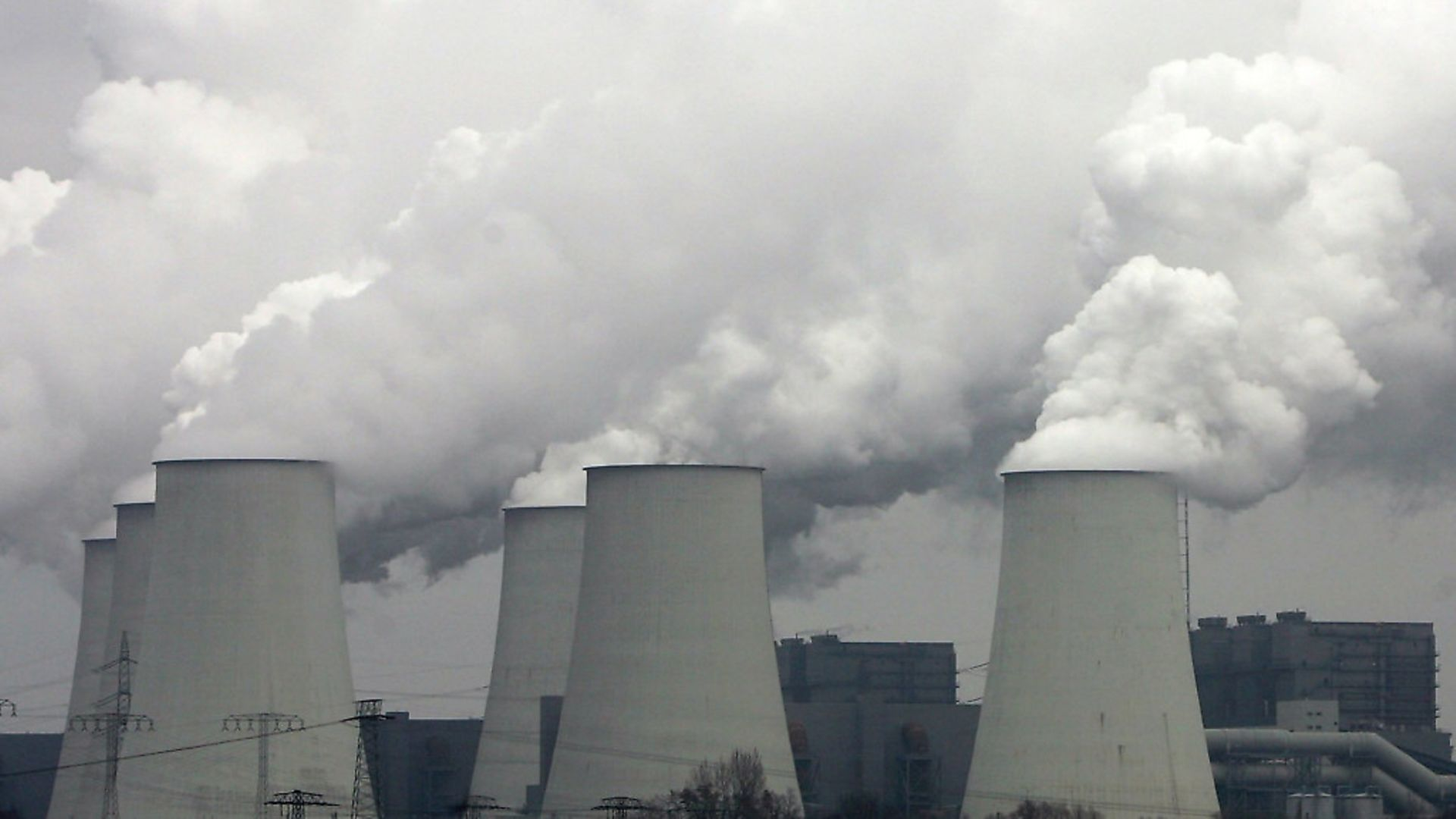 Exhaust plumes from cooling towers at the Jaenschwalde lignite coal-fired power station. Photo: Getty Images - Credit: Getty Images