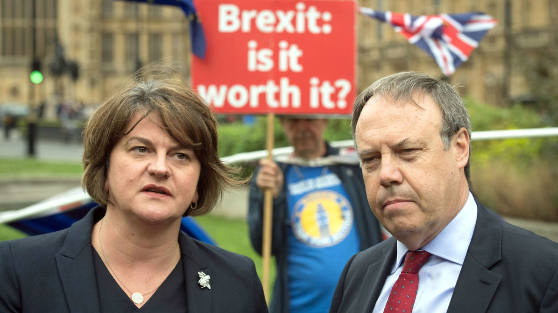 DUP leader Arlene Foster and deputy leader Nigel Dodds pictured with anti-Brexit campaigner Steve Bray - Credit: PA Wire/PA Images