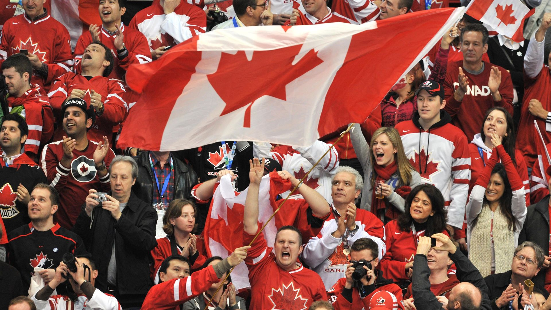 Canadian fans during an Olympic ice hockey match against the US in Vancouver, in 2010 - Credit: AFP via Getty Images