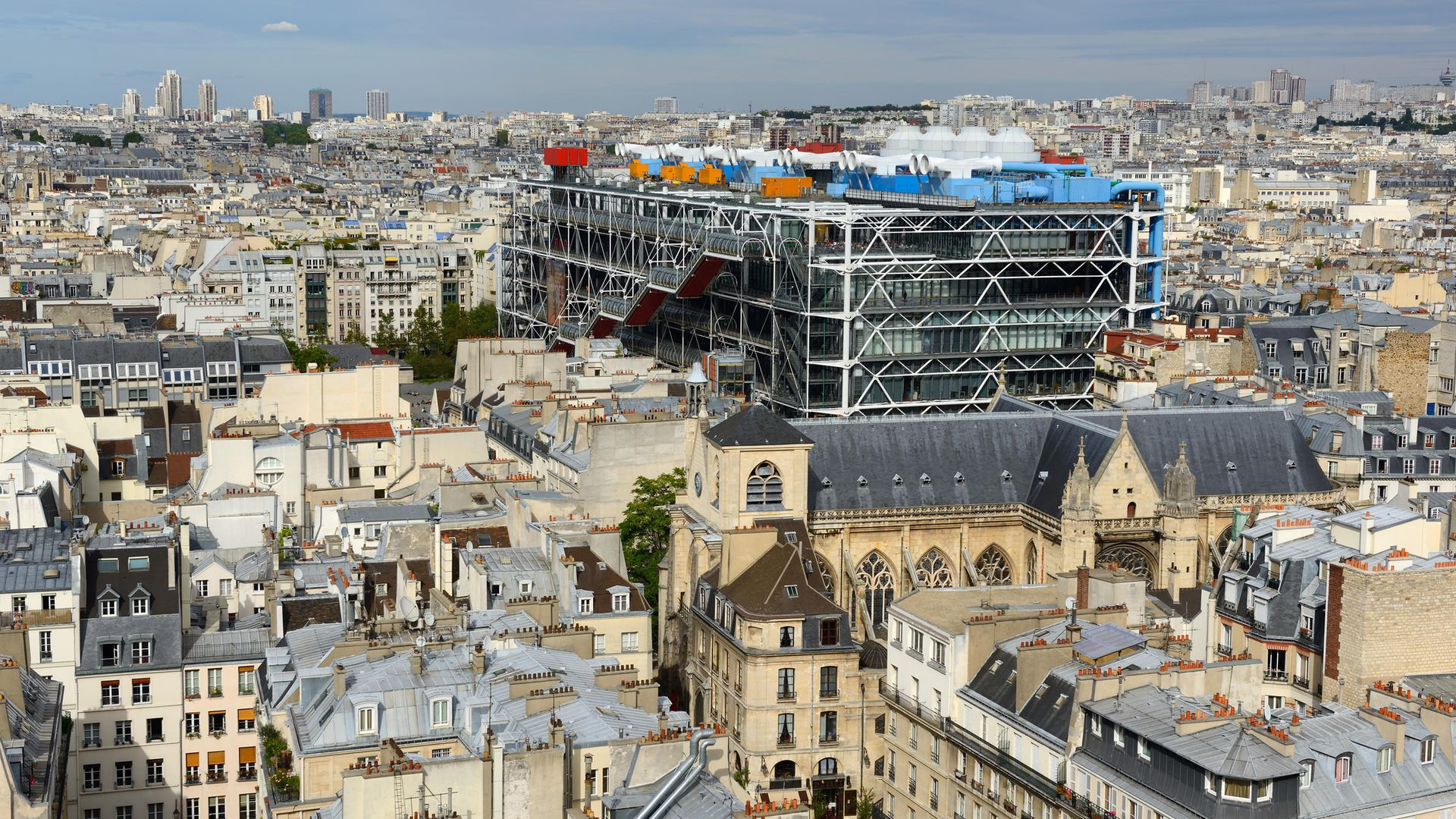 A view of Paris, including the Pompidou Centre in the foreground, from the Tour Saint-Jacques - Credit: Corbis via Getty Images