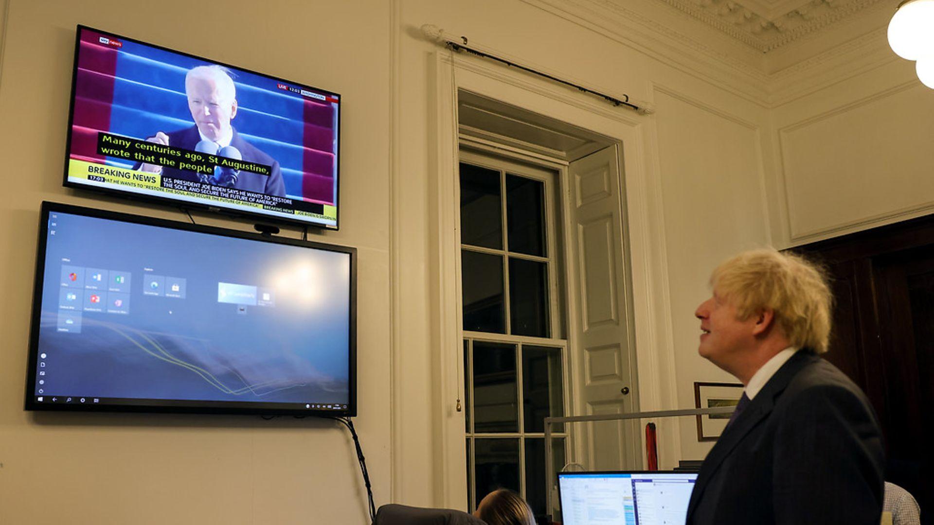 Boris Johnson watches Joe Biden's inauguration speech - Credit: Pippa Fowles / No10 Downing Stre
