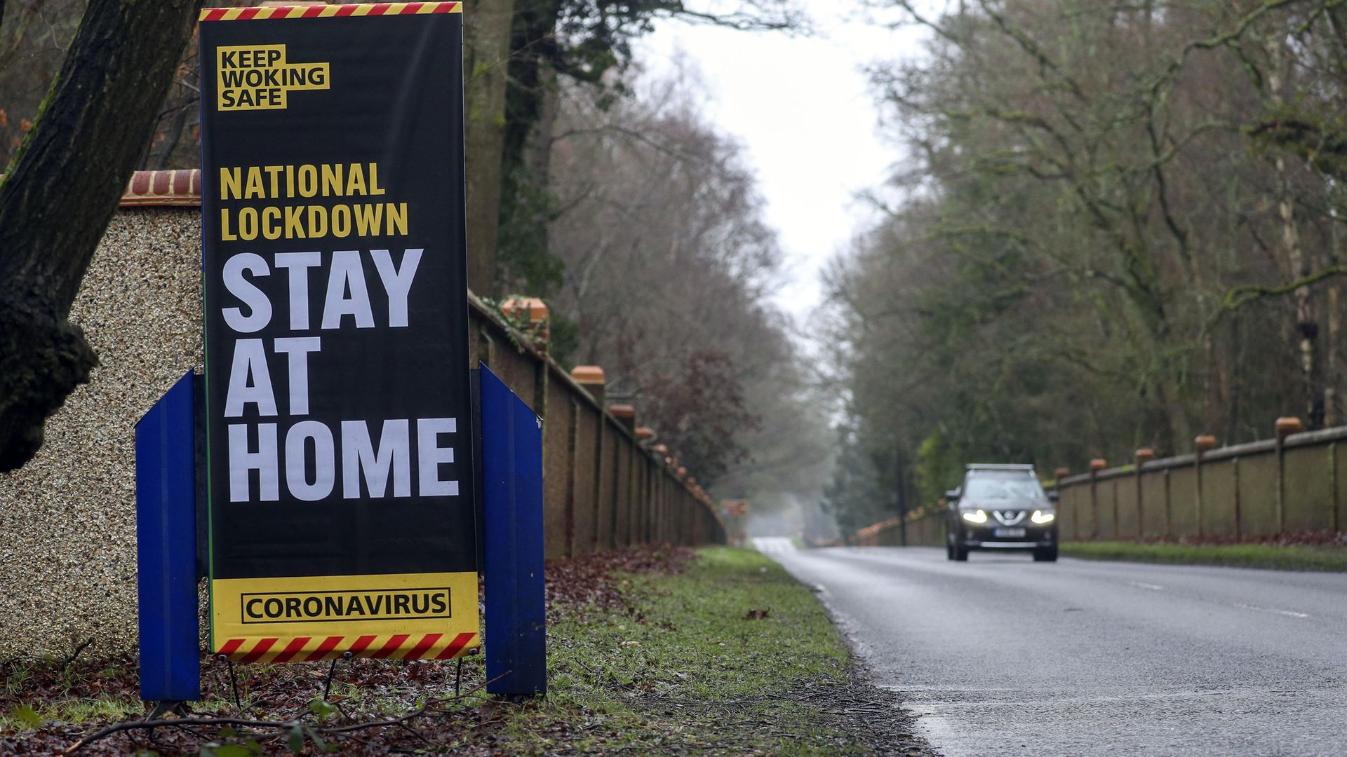 A coronavirus information sign in Brookwood, Surrey, during England's third national lockdown to curb the spread of coronavirus - Credit: PA