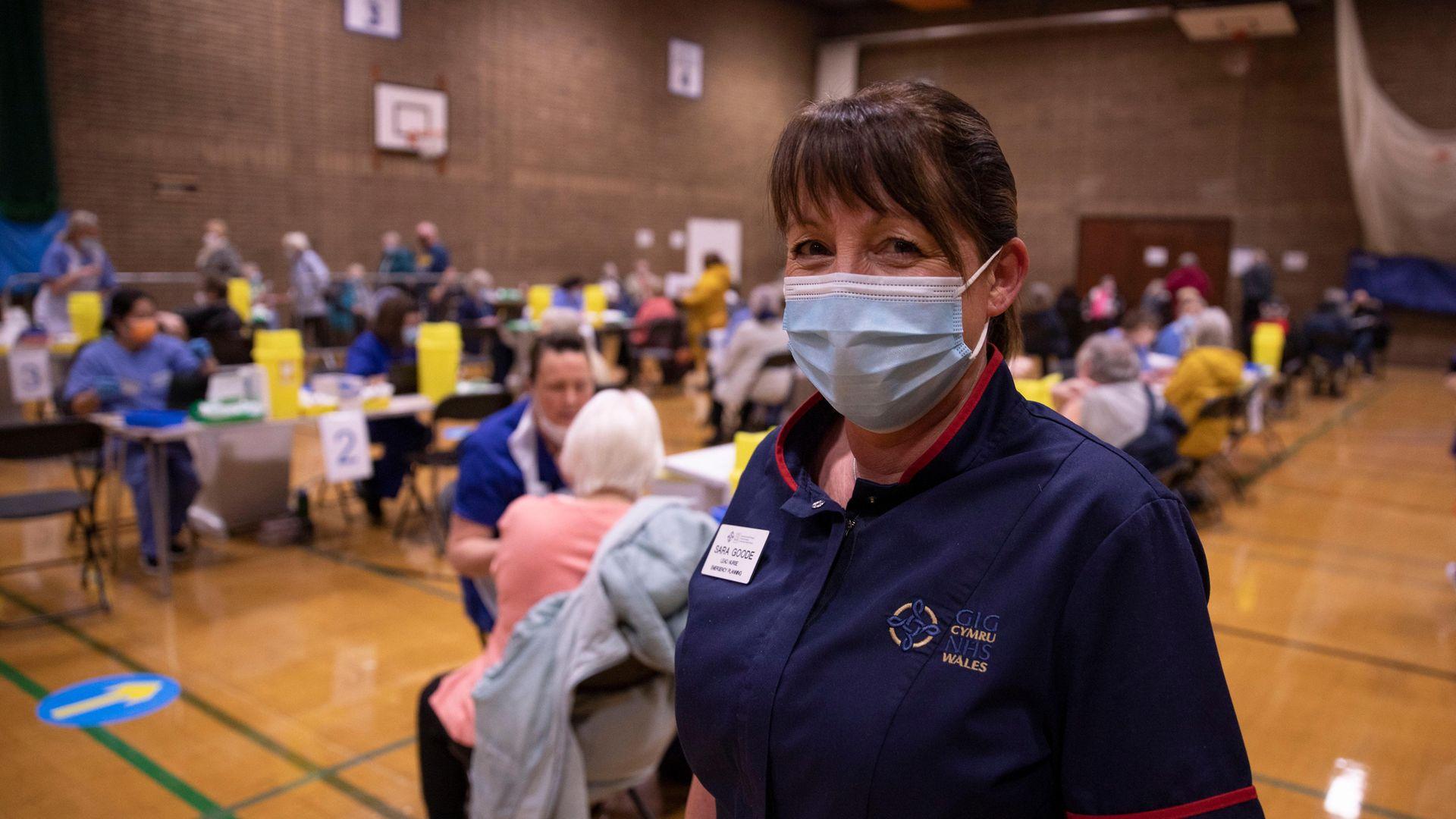 Sarah Jane Goode, a nurse at Aneurin Bevan University Health Board Trust, at a vaccine hub in Newbridge, Wales - Credit: Getty Images