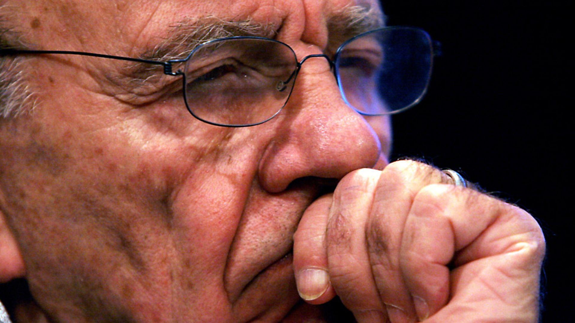 Rupert Murdoch listens to a gathering of reporters immediately following a shareholder meeting. (AP Photo/Bebeto Matthews) - Credit: AP/Press Association Images