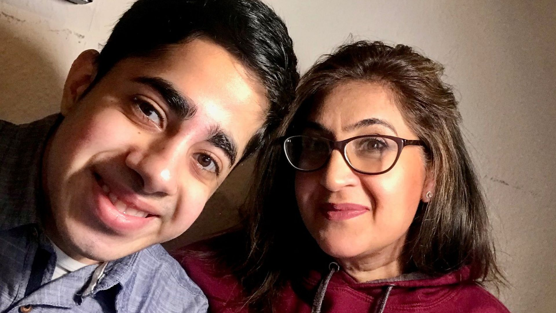 """Faizan Sheikh with his mother. The student, who has a severe stammer, has described US President Joe Biden as an """"inspiration"""" for opening up about his own speech condition. - Credit: PA"""