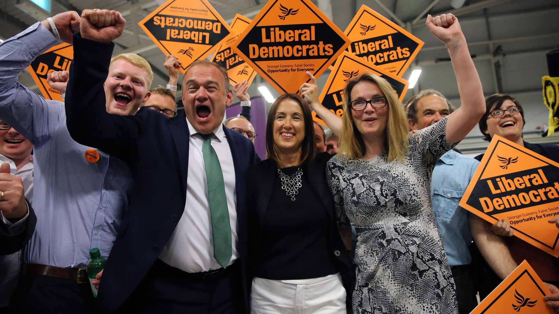 Ed Davey, now party leader, celebrates with Jane Dodds (C) and her team, after she won the Brecon and Radnorshire byelection in August 2019 - Credit: AFP via Getty Images