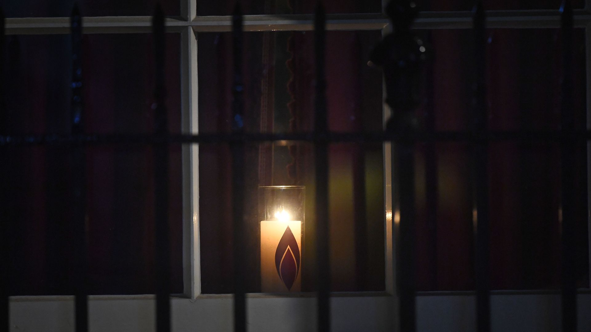 A candle in a window at 10 Downing Street, London, in remembrance of victims of The Holocaust - Credit: PA