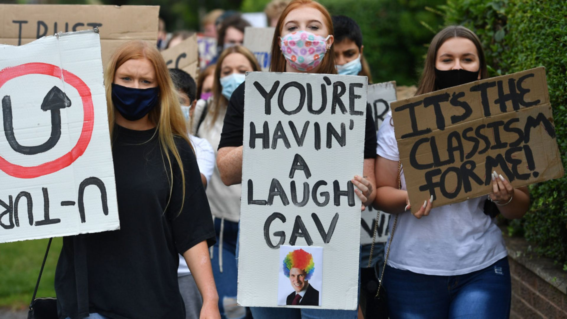 Students from Codsall Community High School march to the constituency office of their local MP Gavin Williamson, who is also the education secretary - Credit: PA