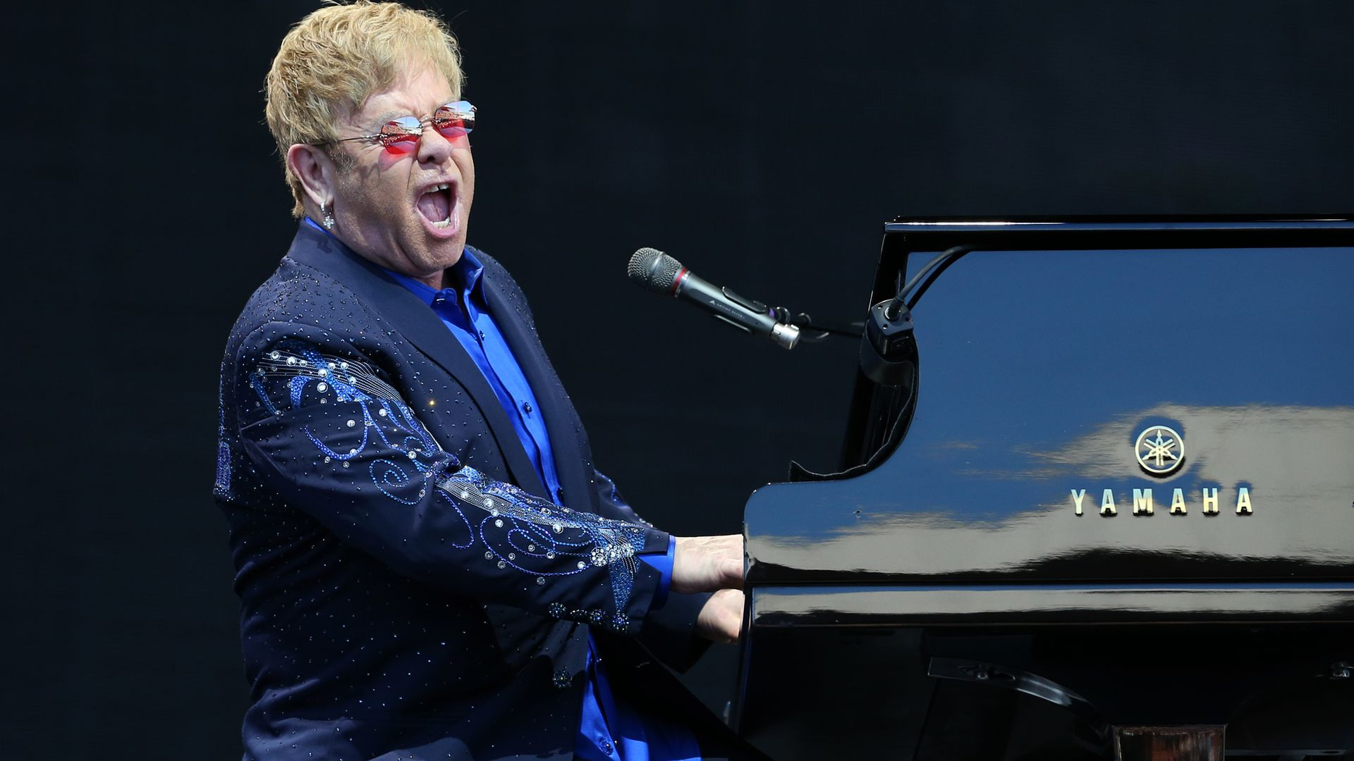 Elton John performing on stage - Credit: PA